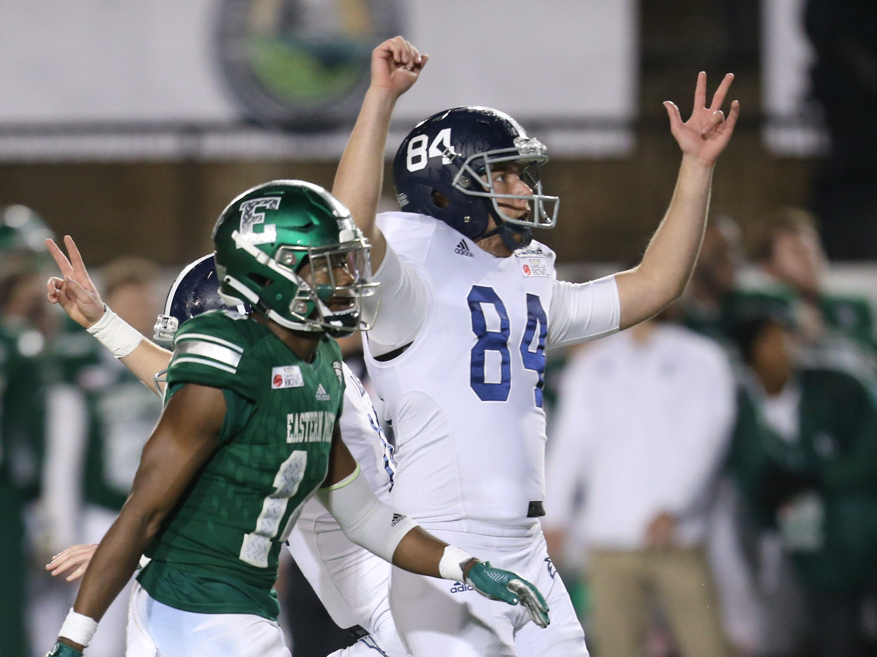 Georgia Southern Eagles punter Magill Bauerle (84) celebrates the game-winning field goal by kicker Tyler Bass that beat the Eastern Michigan Eagles in the Camellia Bowl.