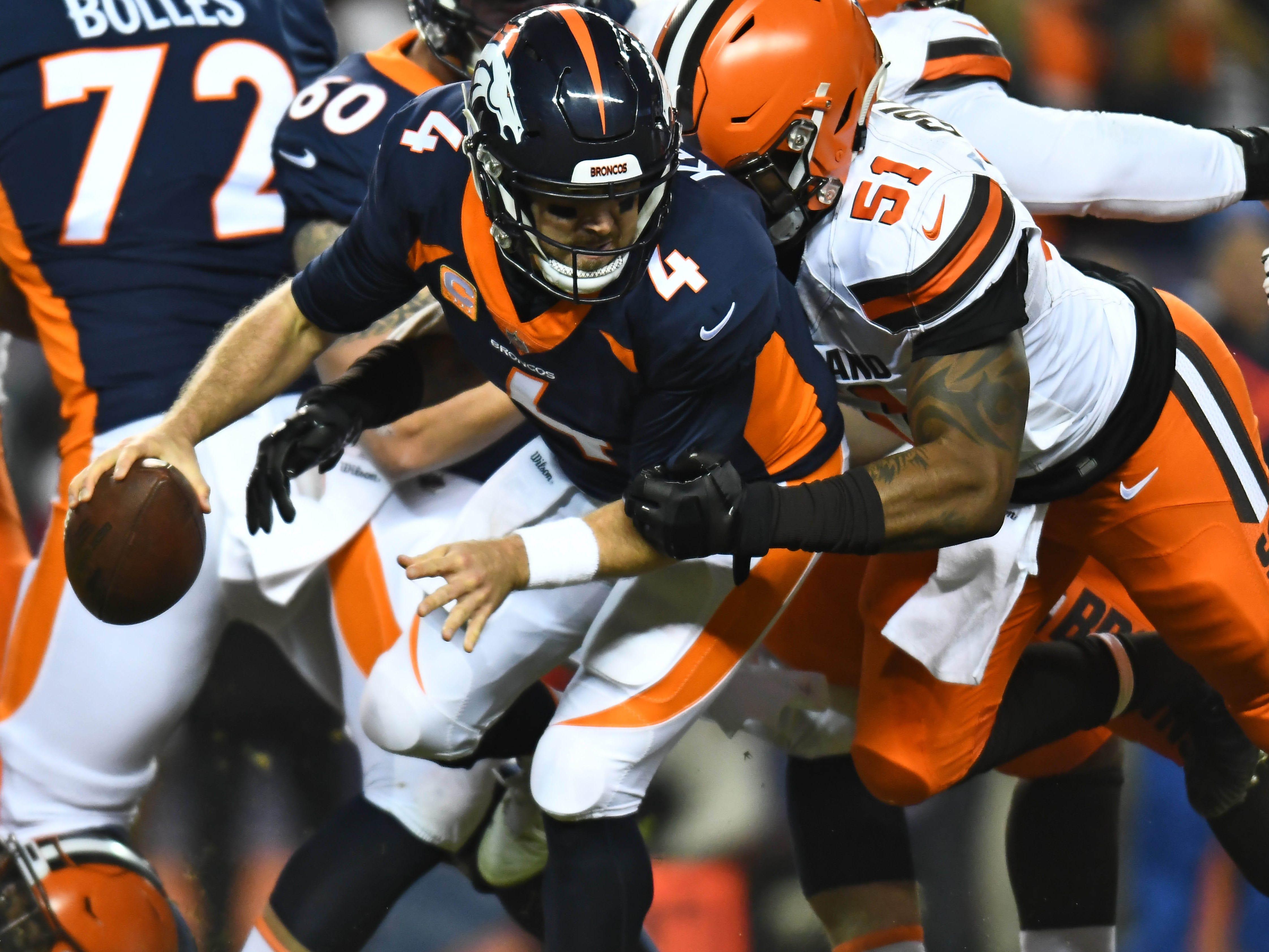 Dec 15, 2018; Denver, CO, USA; Cleveland Browns outside linebacker Jamie Collins (51) sacks Denver Broncos quarterback Case Keenum (4) in the first quarter at Broncos Stadium at Mile High. Mandatory Credit: Ron Chenoy-USA TODAY Sports ORG XMIT: USATSI-381591 ORIG FILE ID:  20181215_sal_ac4_1828.JPG