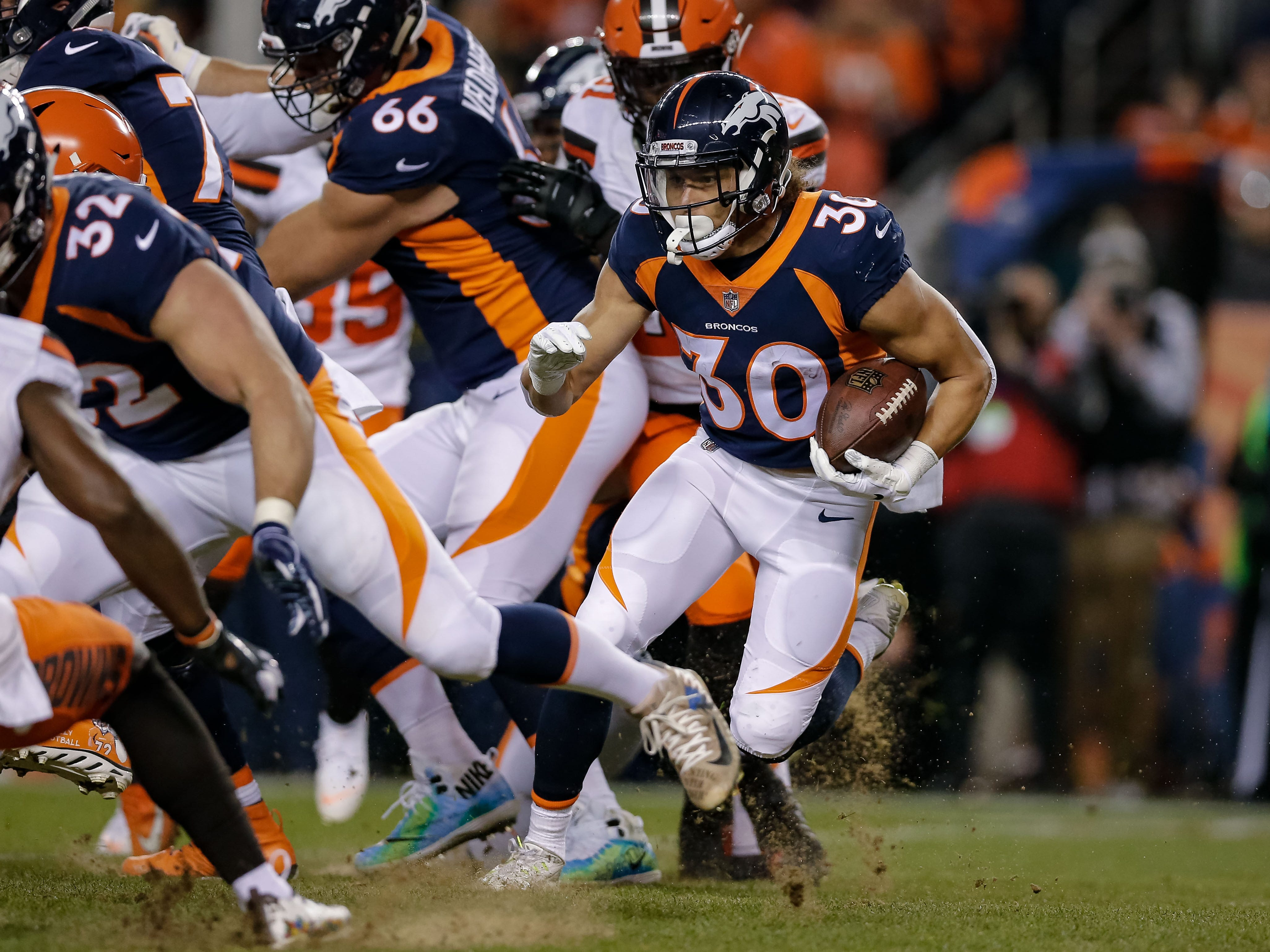 Denver Broncos running back Phillip Lindsay (30) runs the ball in the first quarter against the Cleveland Browns at Broncos Stadium at Mile High.