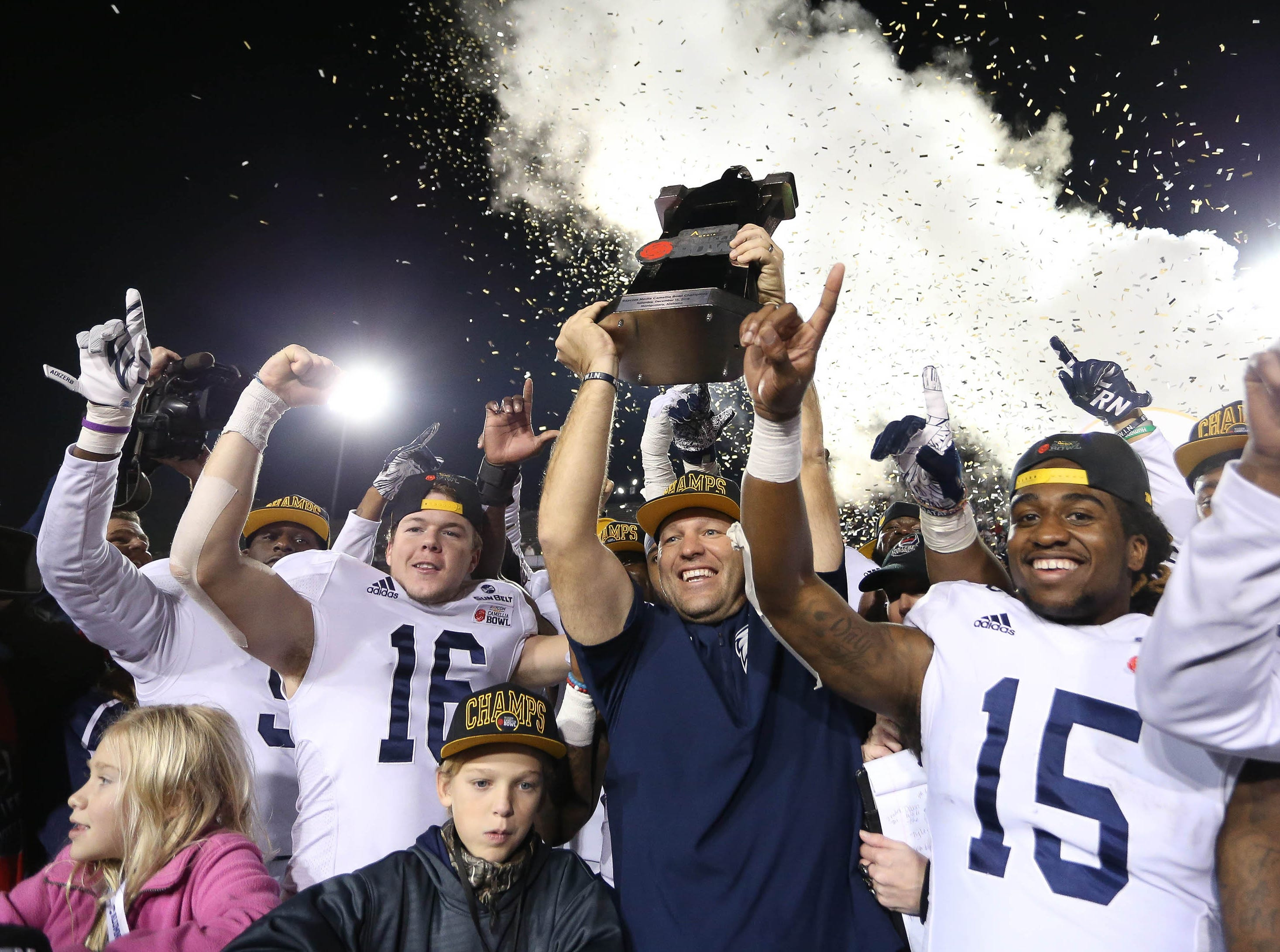 Georgia Southern Eagles head coach Chad Lunsford receives the Camellia Bowl trophy after defeating the Eastern Michigan Eagles.