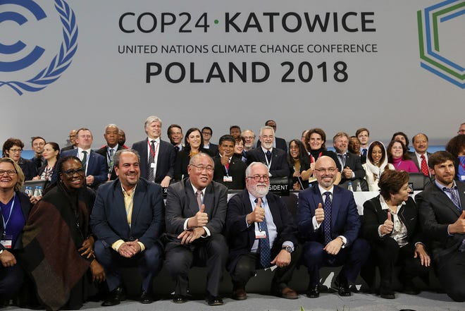 Heads of the delegations react at the end of the final session of the COP24 summit on climate change in Katowice, Poland, on Dec. 15, 2018.
