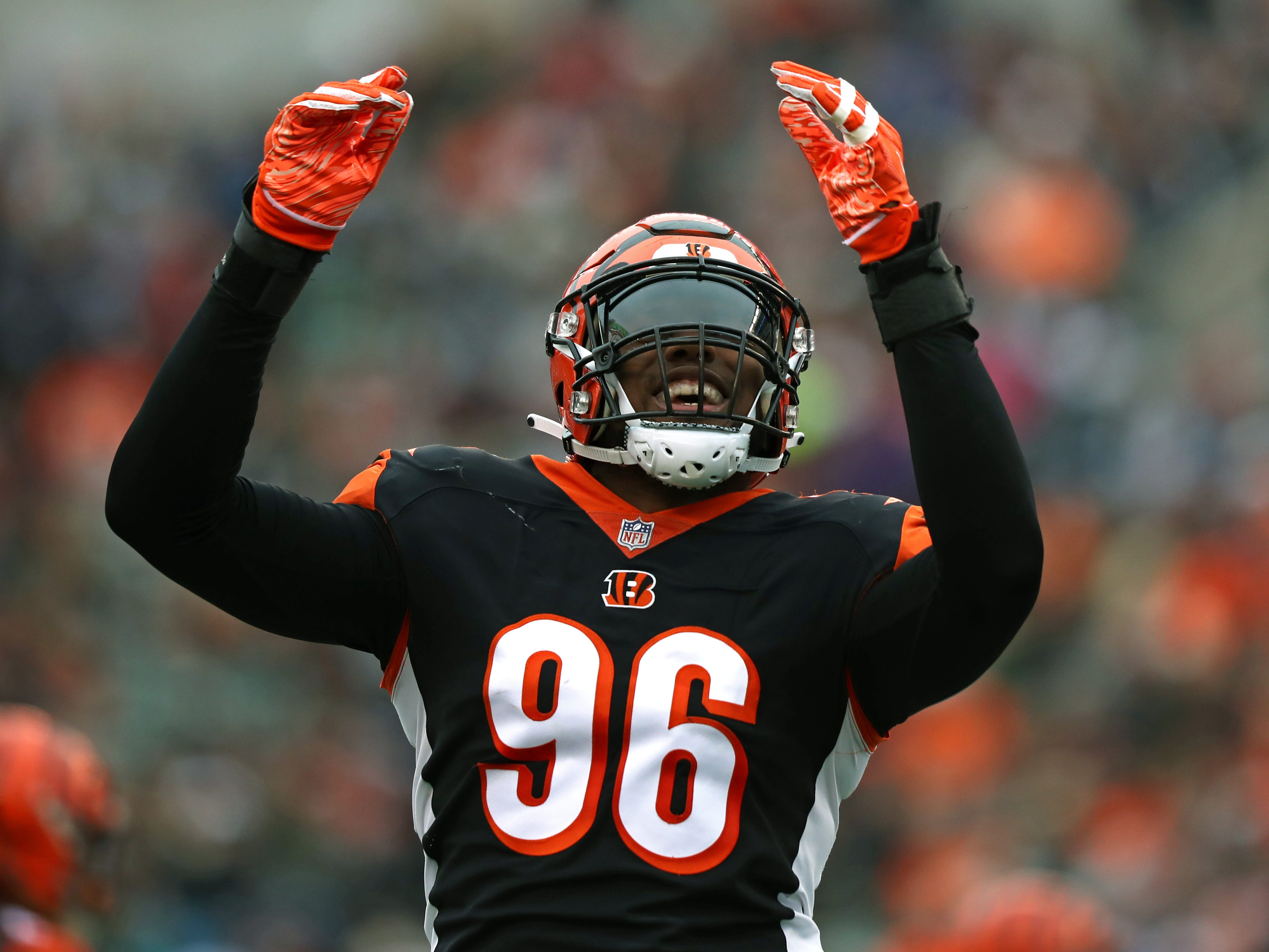 Bengals defensive end Carlos Dunlap reacts against the Raiders in the first half.