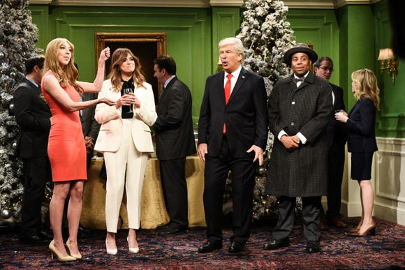 "Heidi Gardner (as Hernia Trump, from left), Cecily Strong (Melania Trump), Alec Baldwin (Donald Trump) and Kenan Thompson (as Clarence the angel) show the president ""It's a Wonderful Trump"" on ""Saturday Night Live."""