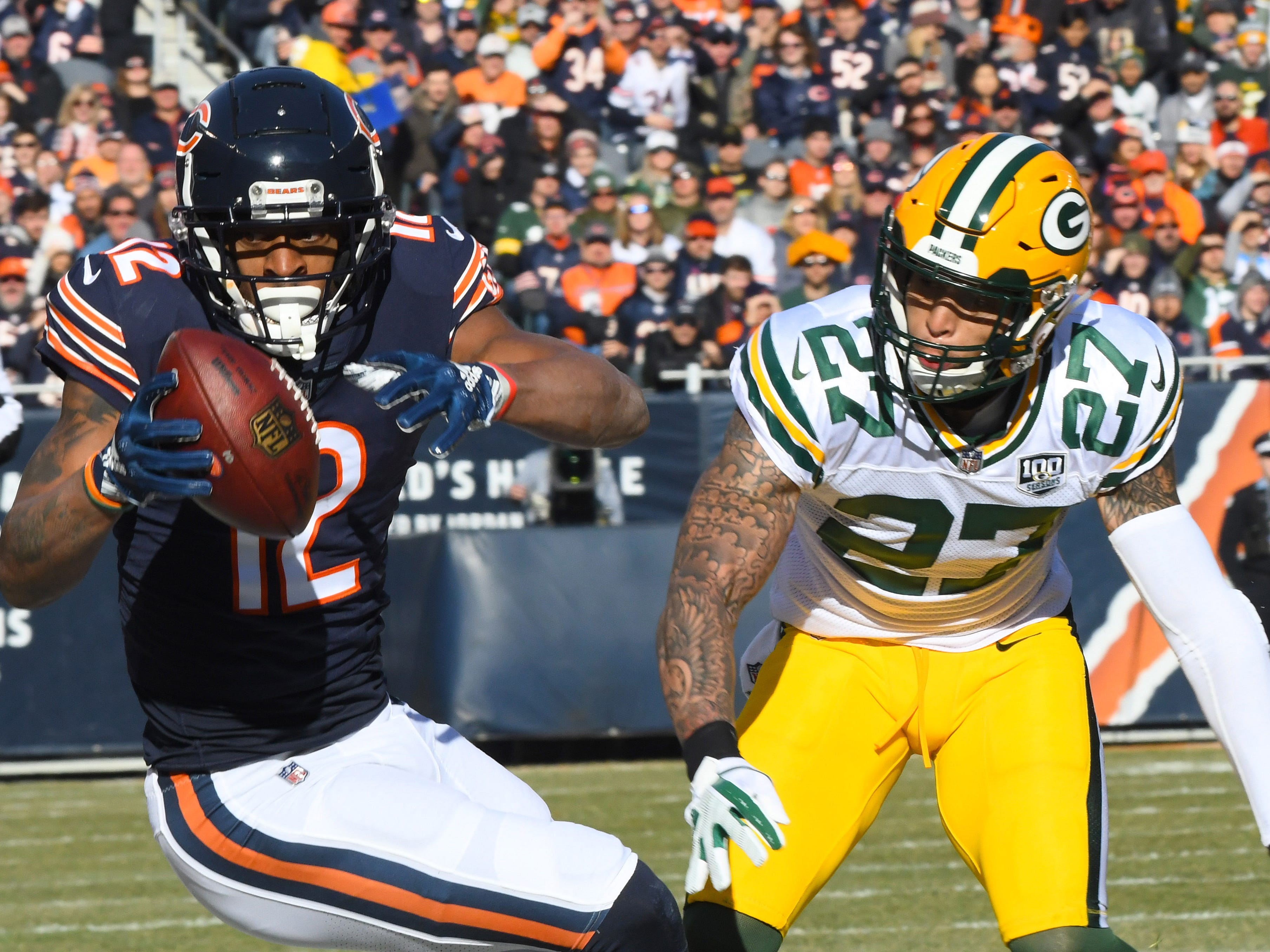 Bears wide receiver Allen Robinson (12) makes a catch against Packers defensive back Josh Jones (27).