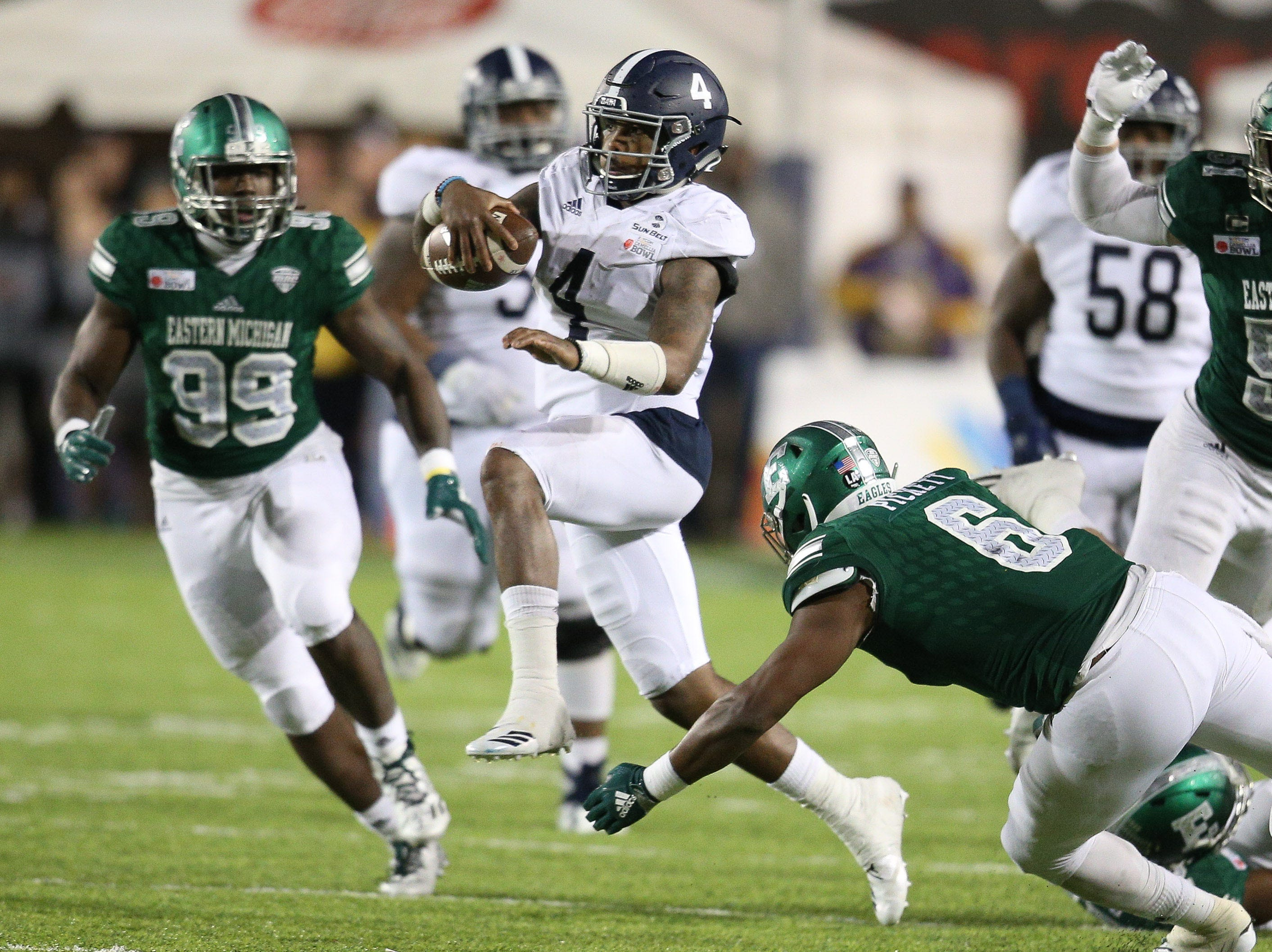 Georgia Southern Eagles quarterback Shai Werts (4) carries the ball for a first down late in the game against Eastern Michigan Eagles in the Camellia Bowl.