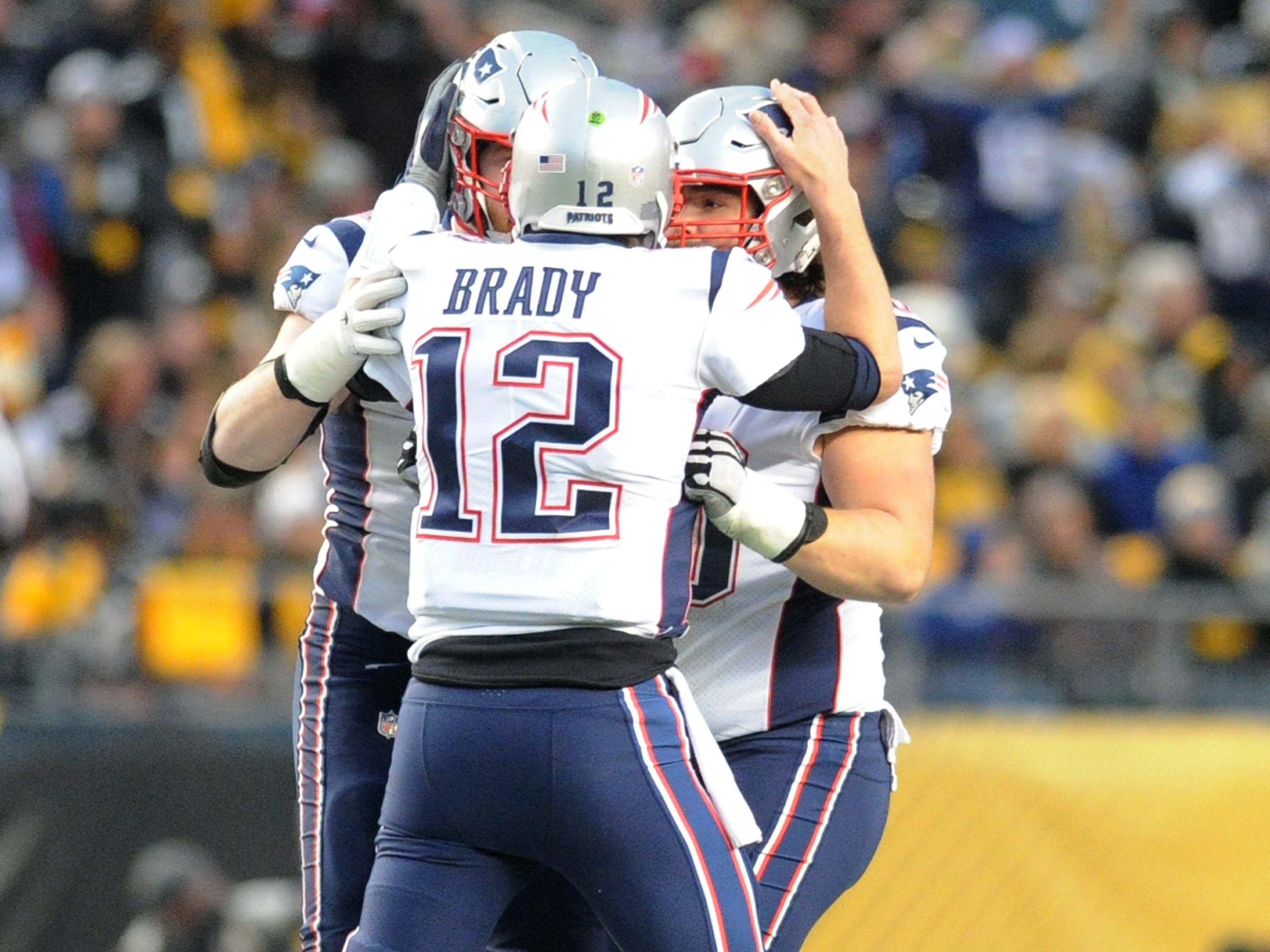 New England Patriots quarterback Tom Brady (12) celebrates a first quarter touchdown against the Pittsburgh Steelers at Heinz Field.