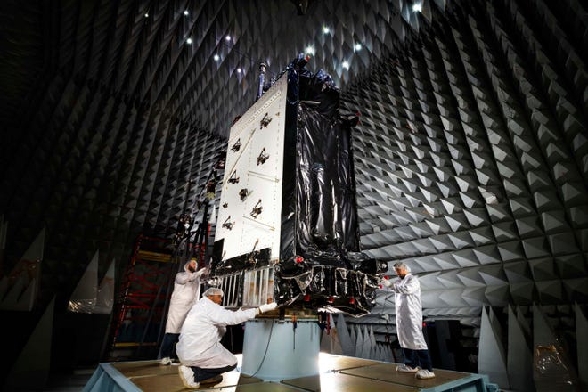 This March 22, 2016, photo provided by Lockheed Martin shows the first GPS III satellite inside the anechoic test facility at Lockheed Martin's complex south of Denver. The facility is used to ensure the signals from the satellite's components and payload will not interfere with each other. The satellite is scheduled to be launched from Cape Canaveral, Fla., on Tuesday, Dec. 18, 2018.