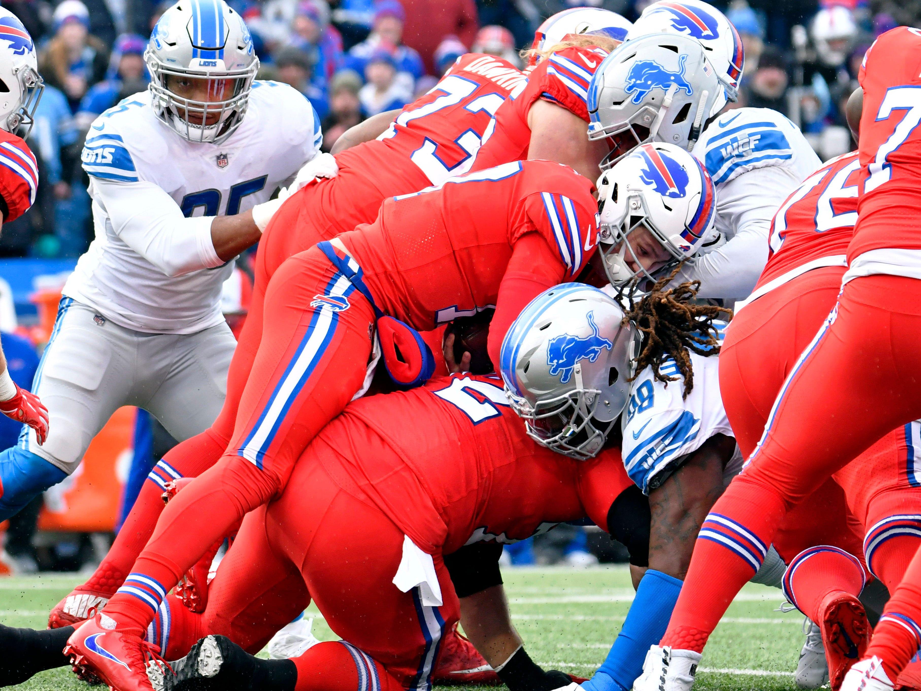Bills quarterback Josh Allen (17) runs a quarterback sneak for a first down against the Lions.