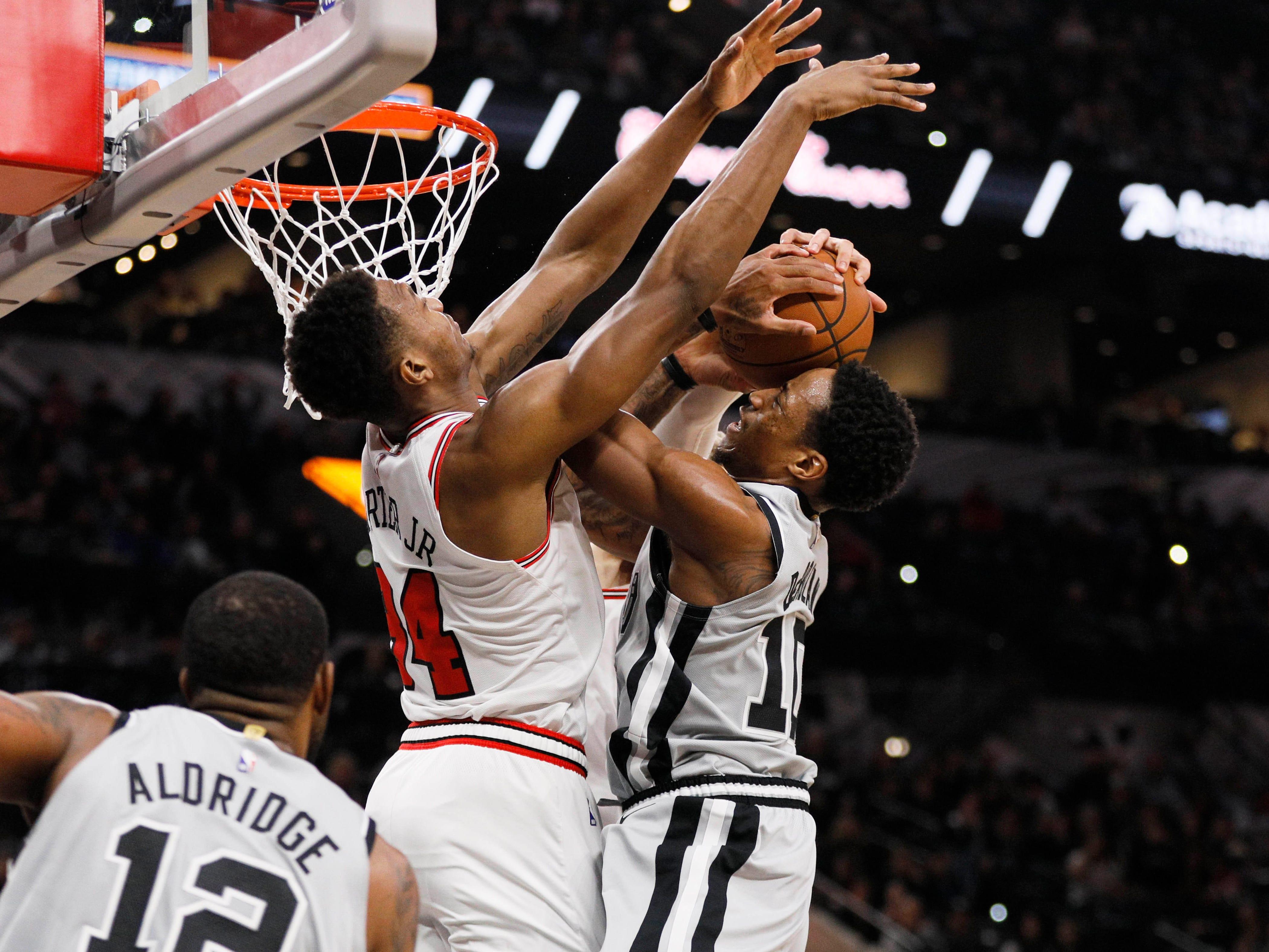 Dec. 15: Bulls defender Wendell Carter Jr. (34) meets Spurs guard DeMar DeRozan (10) at the rim during the second half in San Antonio.