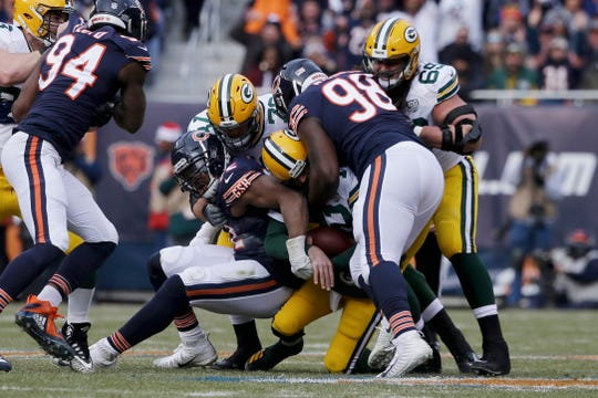 Chicago LB Khalil Mack, left, and DT Bilal Nichols (98) sack Green Bay QB Aaron Rodgers on Sunday.
