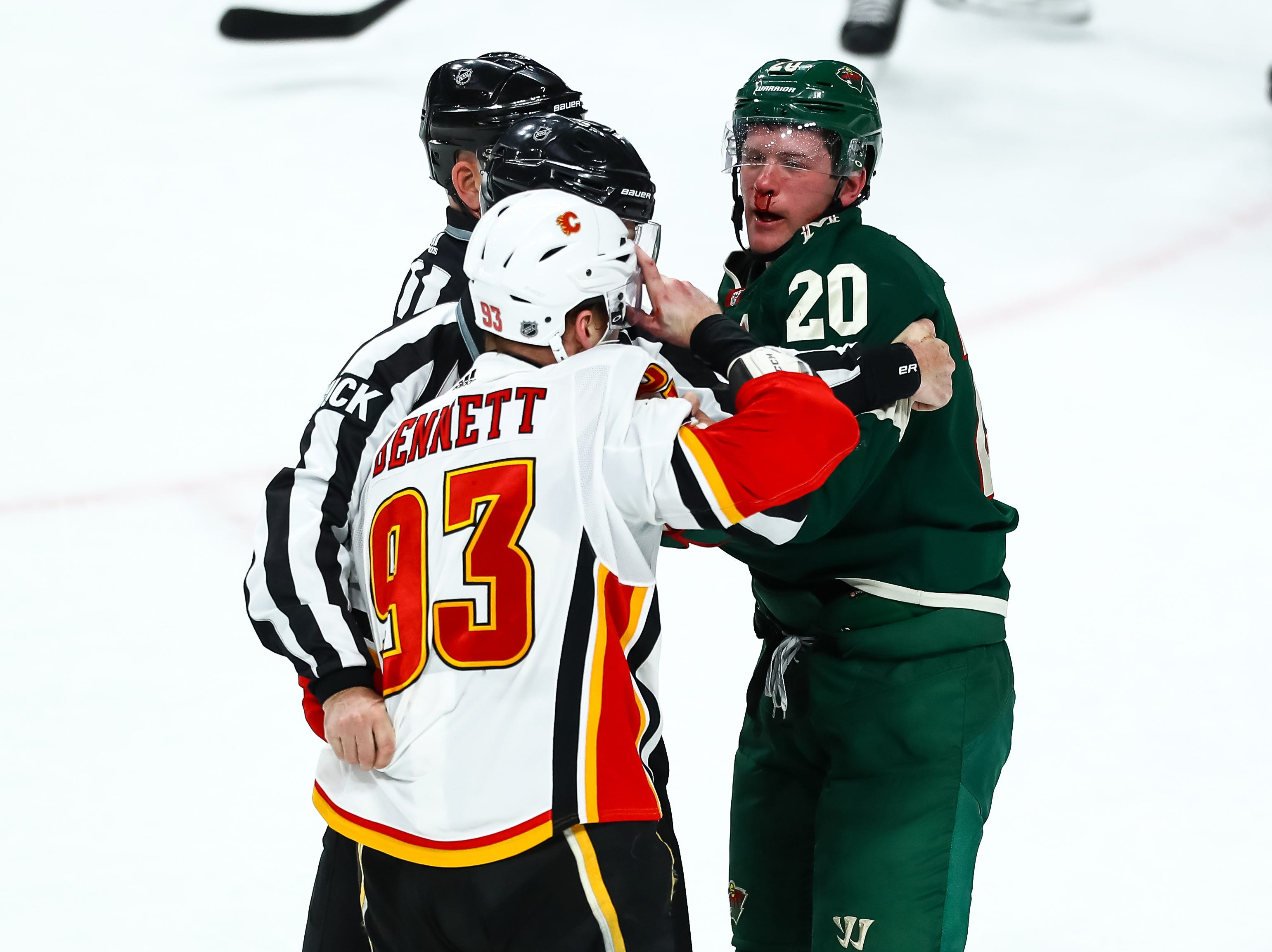 Dec 15: Calgary Flames' Sam Ben.nett (93) vs. Minnesota Wild's Ryan Suter.