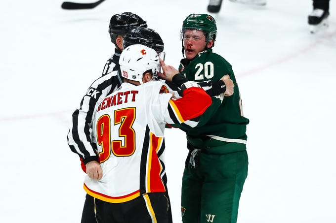 Dec 15: Calgary Flames' Sam Ben.nett (93) vs. Minnesota Wild's Ryan Suter.