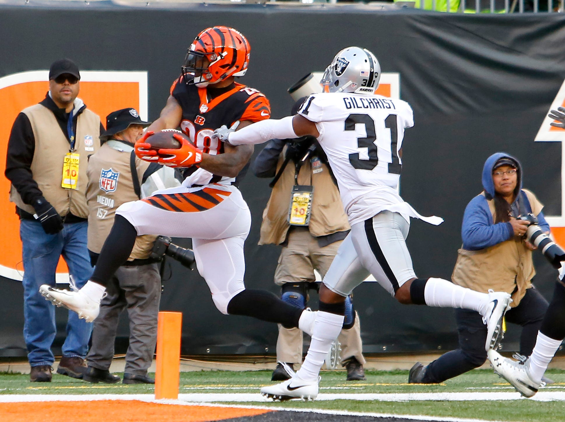 Cincinnati Bengals running back Joe Mixon (28) scores a touchdown ahead of Oakland Raiders strong safety Marcus Gilchrist (31) during the second half at Paul Brown Stadium.