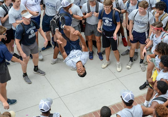 Jason Pugh of Palmetto Boys State city group Coosawhatchie flips in front of Santee during a cheer showdown prior to lunch during the annual week-long June camp at Anderson University.