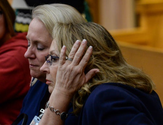 Denise Fredricks, left, Principal at Townville Elementary School, hugs Joanne Avery, right, Superintendent of Anderson County School District Four, during a waiver hearing for Jesse Osborne at the Anderson County Courthouse on Monday, February 12, 2018. They finished watching a video of Jesse Osborne being interviewed in 2016 by investigators.