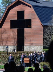 "Family carry the casket for the private funeral service for Billy Graham in a tent outside the Billy Graham Library in Charlotte, N.C. on Friday, March 2, 2018. In his six decades of television, Graham hosted annual ""Crusades"", evangelistic campaigns, which ran from 1947 until his retirement in 2005. On February 28 and March 1, 2018, Billy Graham became the fourth private citizen in United States history to lie in honor at the United States Capitol rotunda in Washington, D.C."