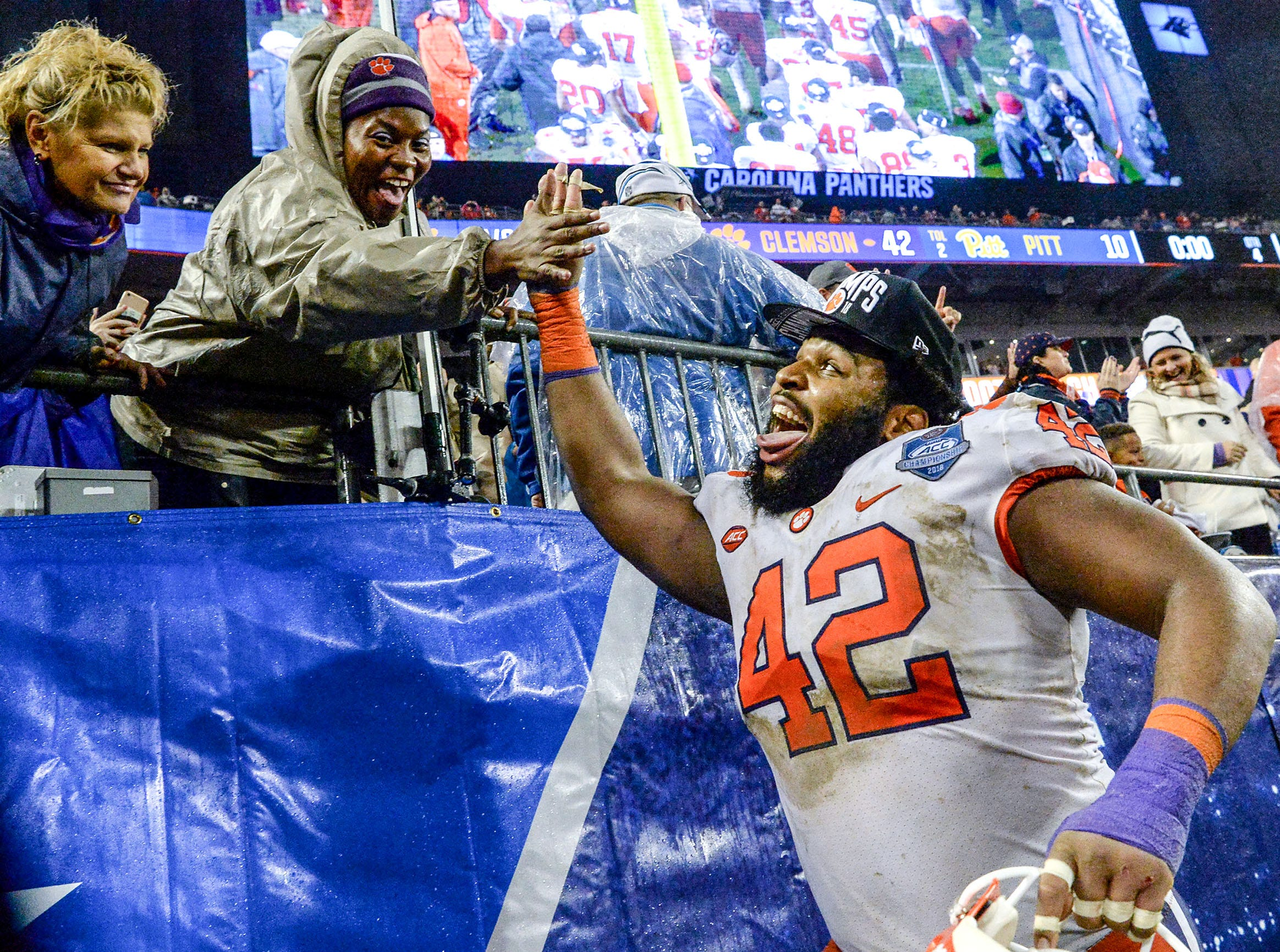 Clemson defensive lineman Christian Wilkins (42) celebrates with fans a 42-10 win over Pittsburgh after the game at the Dr. Pepper ACC football championship at Bank of America Stadium in Charlotte, N.C. on Saturday, December 1, 2018.