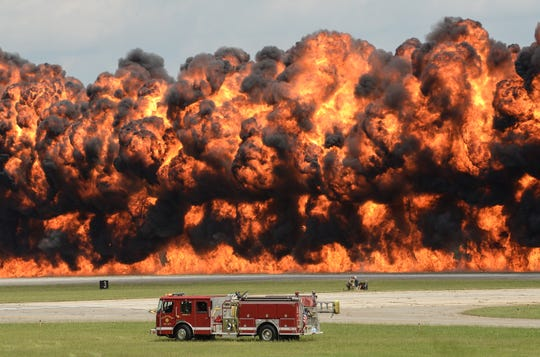 Center Rock fire department truck is dwarfed by the flames created by the Firewalkers International Pyrotechnics demonstration team during the Jo & Bill Trent Regional Airshow May 2018. No one was hurt in the fiery demonstration which got the crowd's approval.