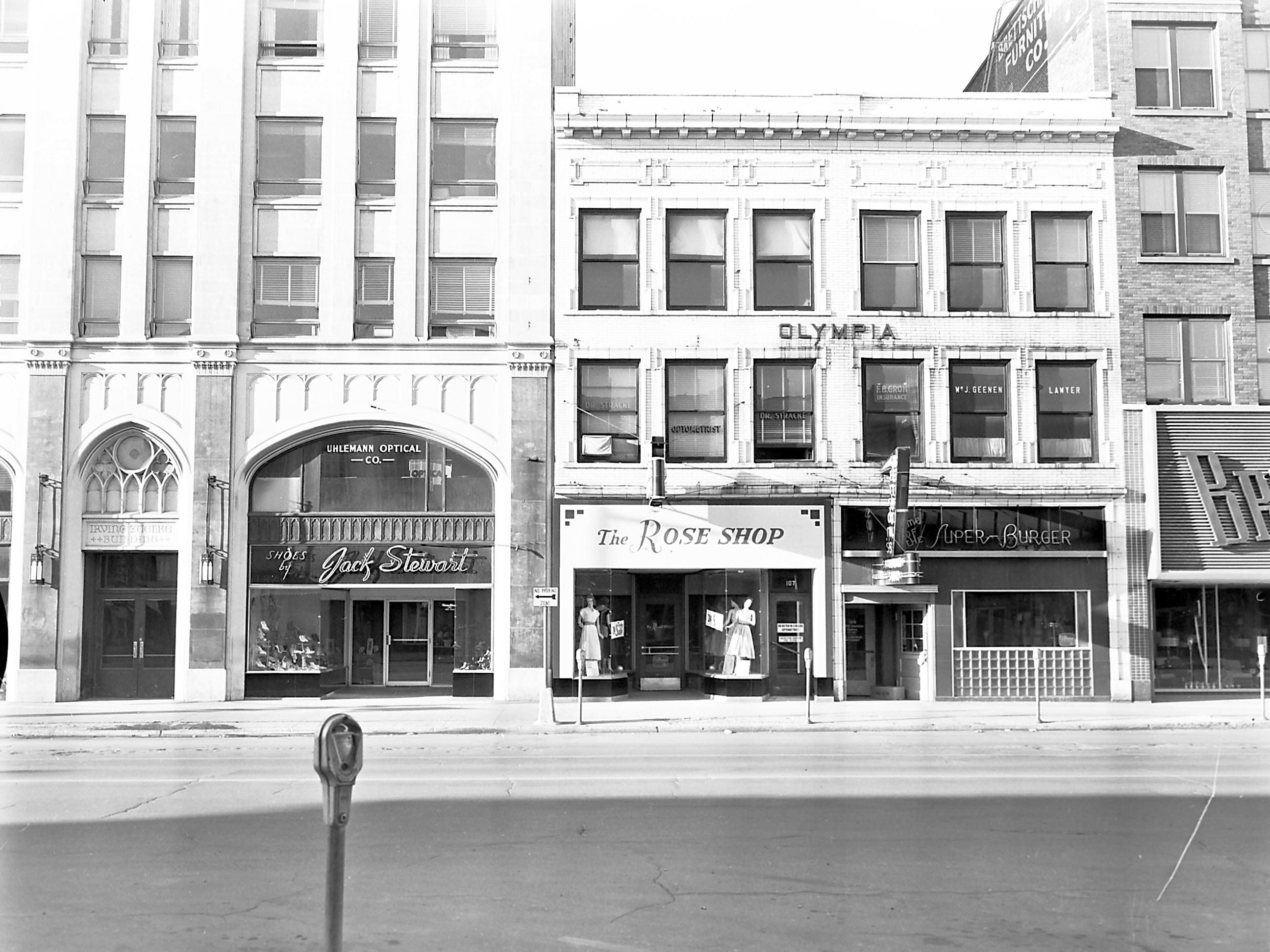 1957 Downtown Appleton. 100 West block on the south side of College Avenue: Zuelke Buillding. Jack Steward Shoes. The Rose Shop. Retson's. Brettschneider Furniture. Post-Crescent photo by staff.