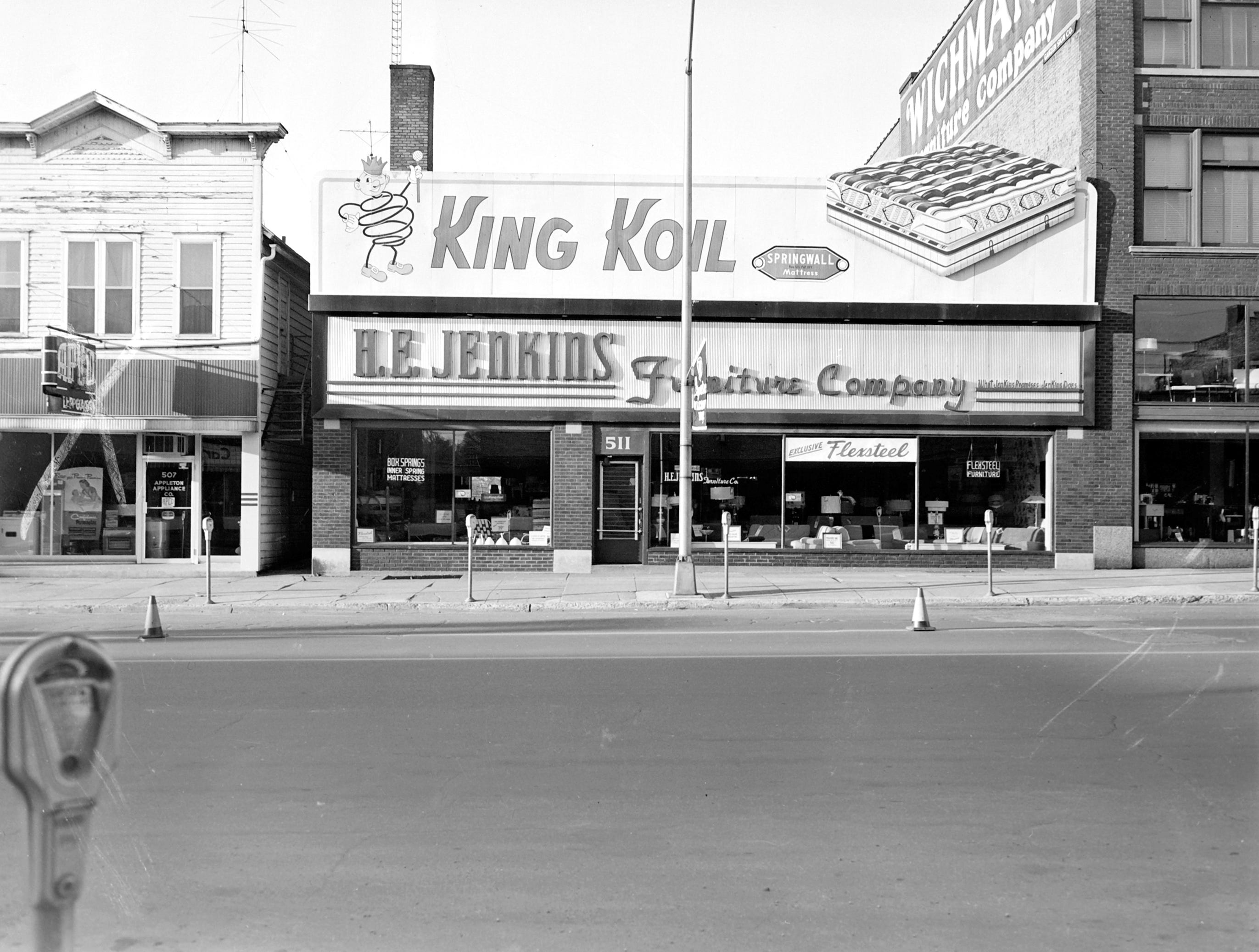 1957 Downtown Appleton. 500 West block on the south side of College Avenue: Appleton Appliance. H. E. Jenkins. Wichmann's. Post-Crescent photo by staff.
