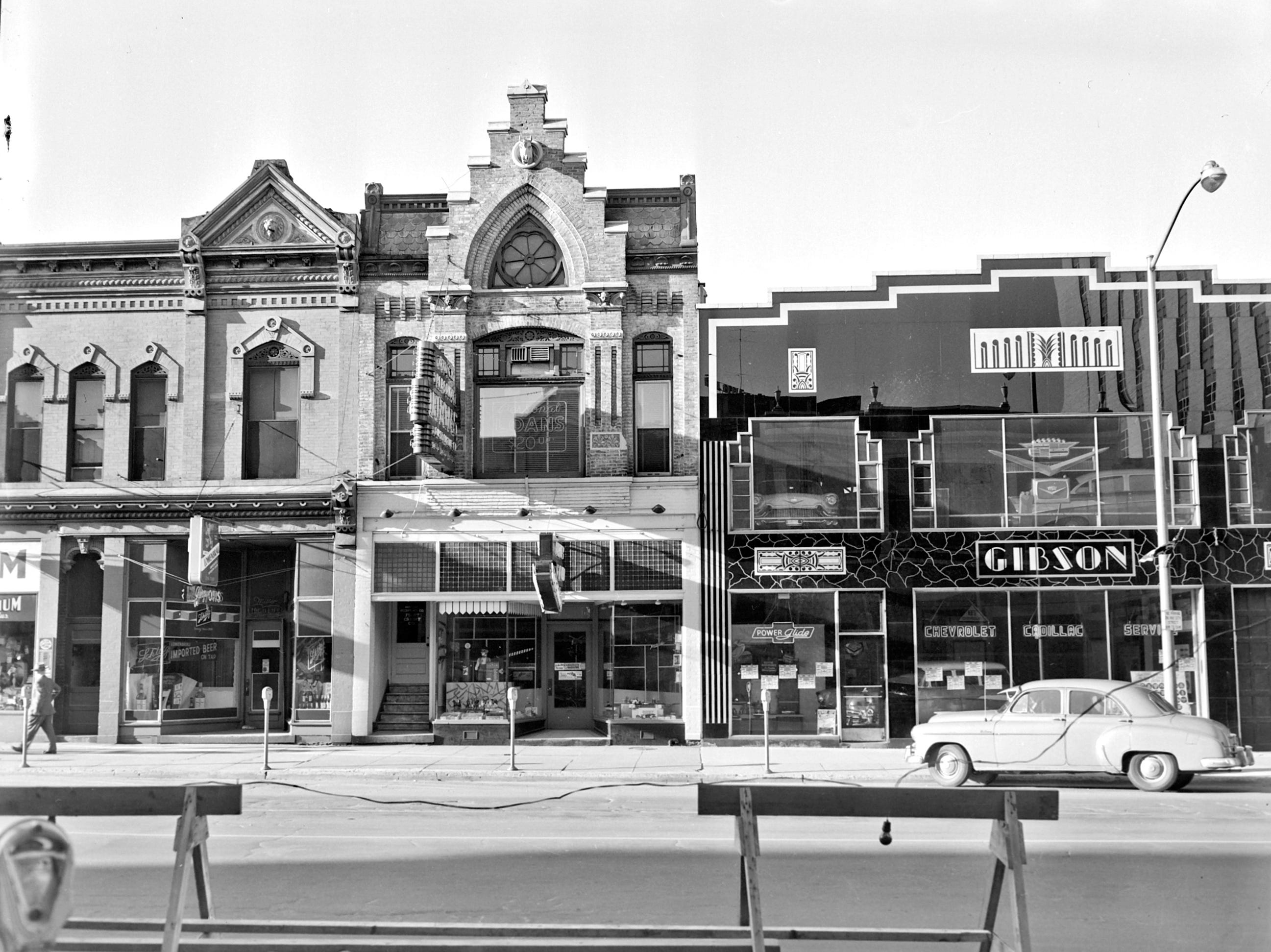 1957 Downtown Appleton. 200 West block on the south side of College Avenue: Vet's Emporium.  George Otis tavern. SHOP. Gibson Motors.  Post-Crescent photo by staff.