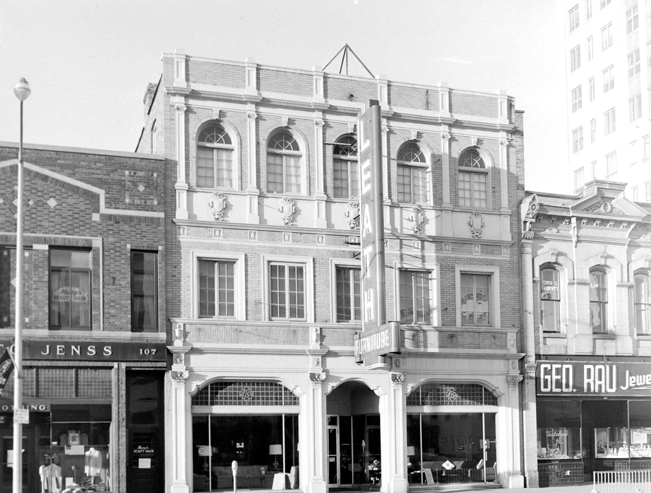 1957 Downtown Appleton. 100 East block on the south side of College Avenue: Otto Jenns Mens Shop. Leath Furniture. Geo. Rau Jewelers.  Post-Crescent photo by staff.