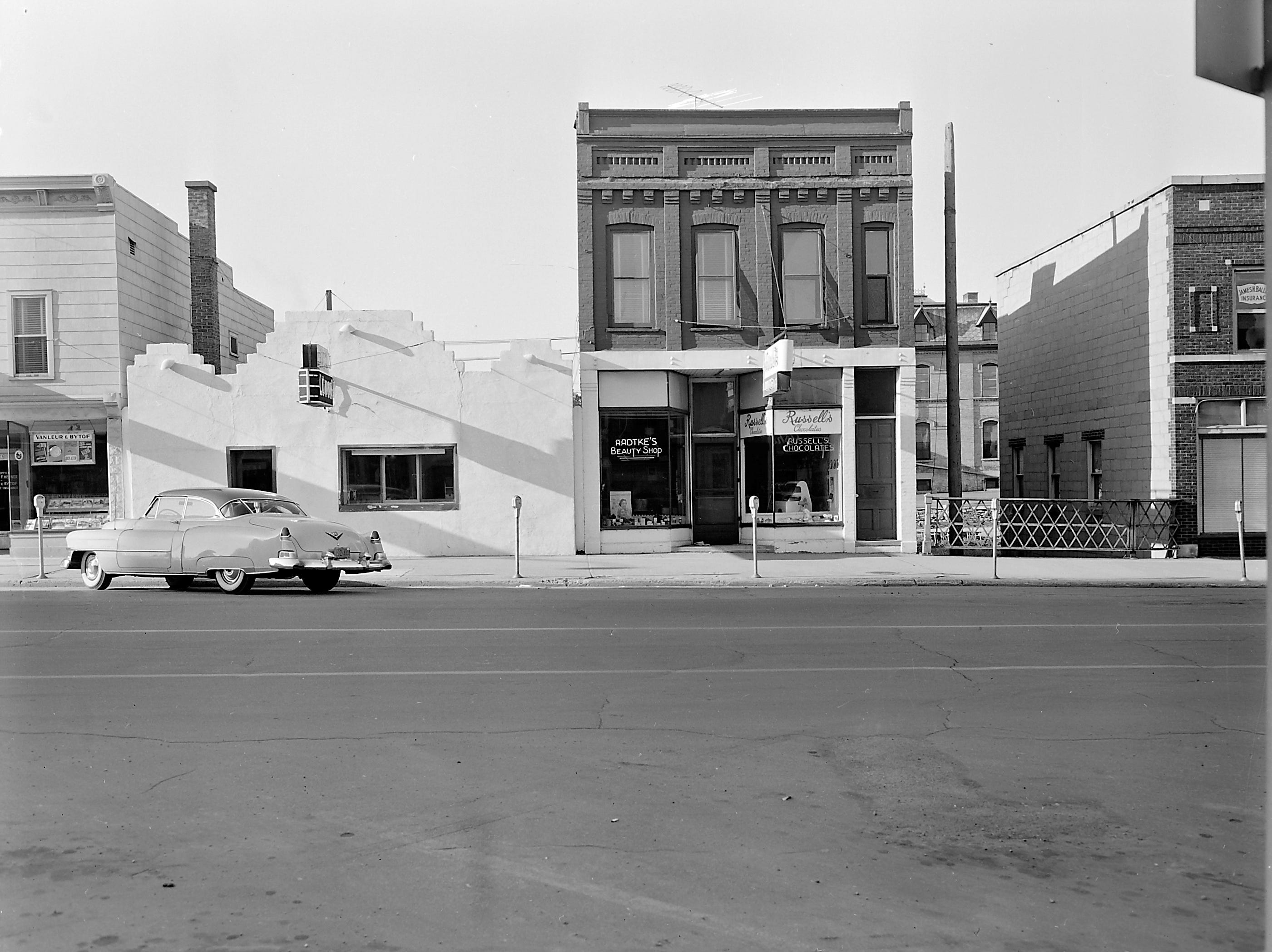 1957 Downtown Appleton. 300 West block on the south side of College Avenue: Vanleur & Bytof. Polzin's Lunch, Radtke's Beauty Shop. Russell's Candies. Post-Crescent photo by staff.