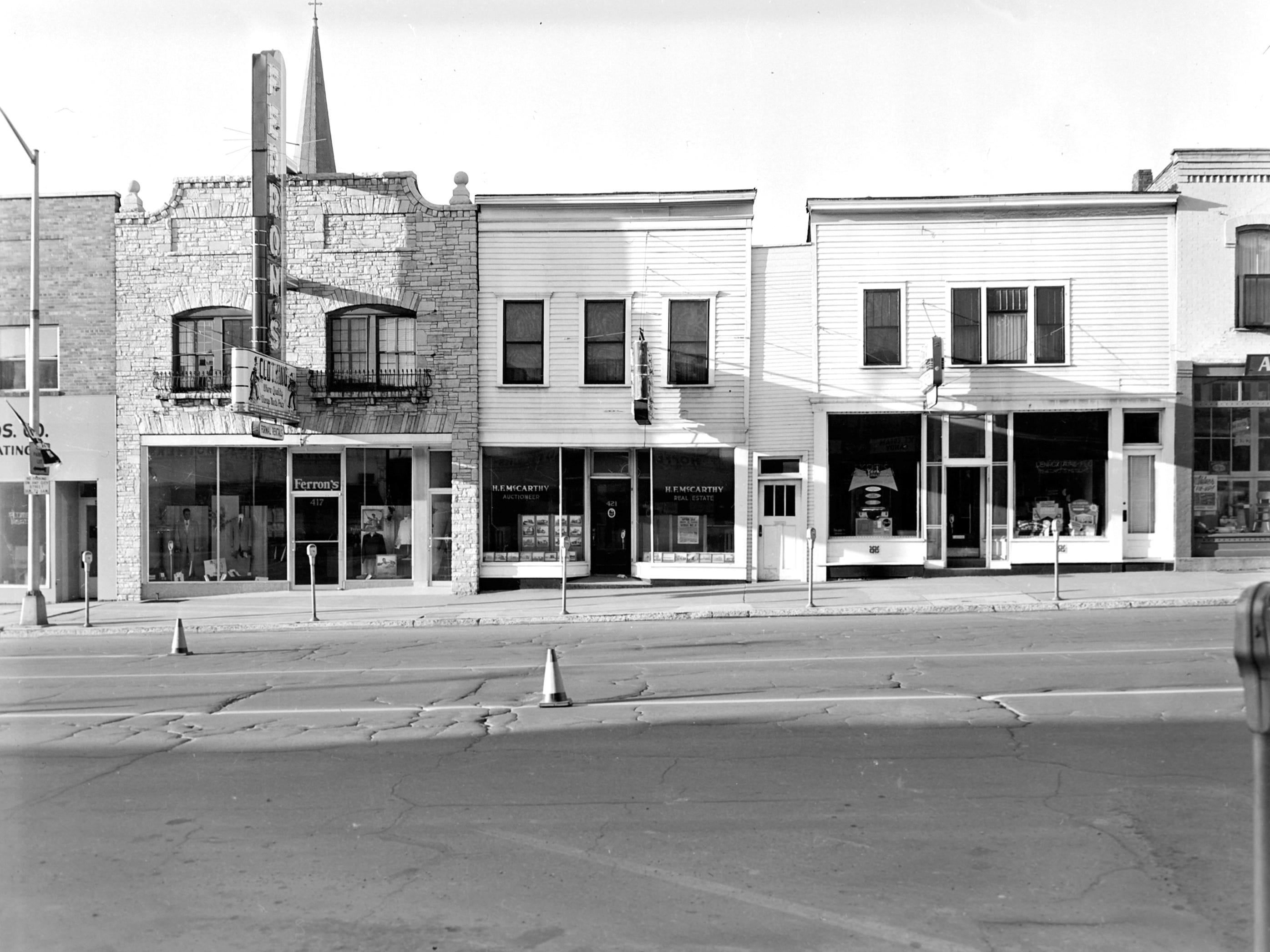 1957 Downtown Appleton.  400 West block on the south side of College Avenue: Wenzel Bros. Co. Plumbing Heating. Ferron's. McCarthy Auctioneer. Building. Appleton Hardware. Post-Crescent photo by staff.