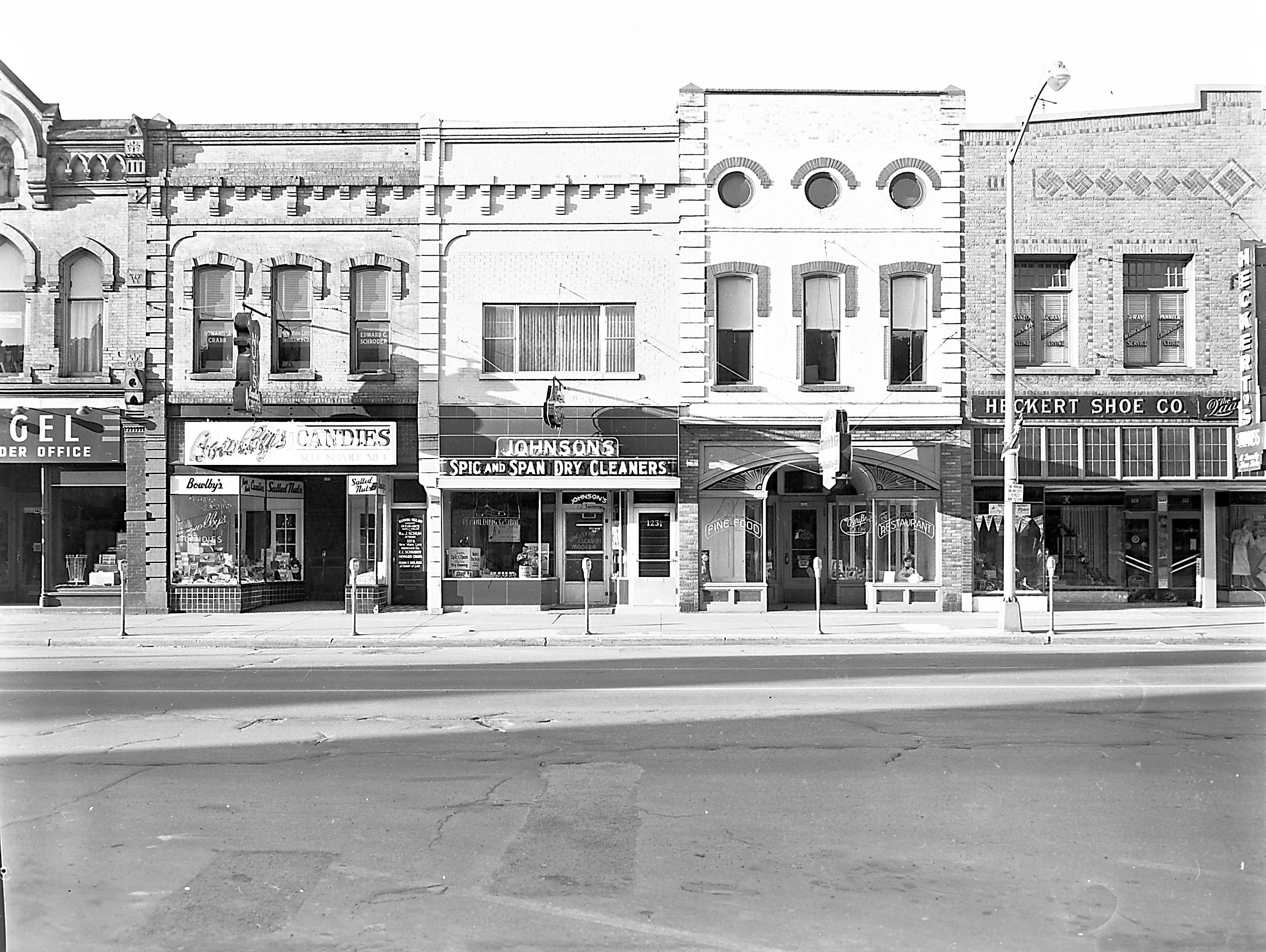 1957 Downtown Appleton. 100 East block on the south side of College Avenue: Spiegel. Peckman Studio (above Spiegel's) Bowlby's Candies. Johnson's Dry Cleaners. Kipps Restaurant. Heckert Shoe Co.  Post-Crescent photo by staff.