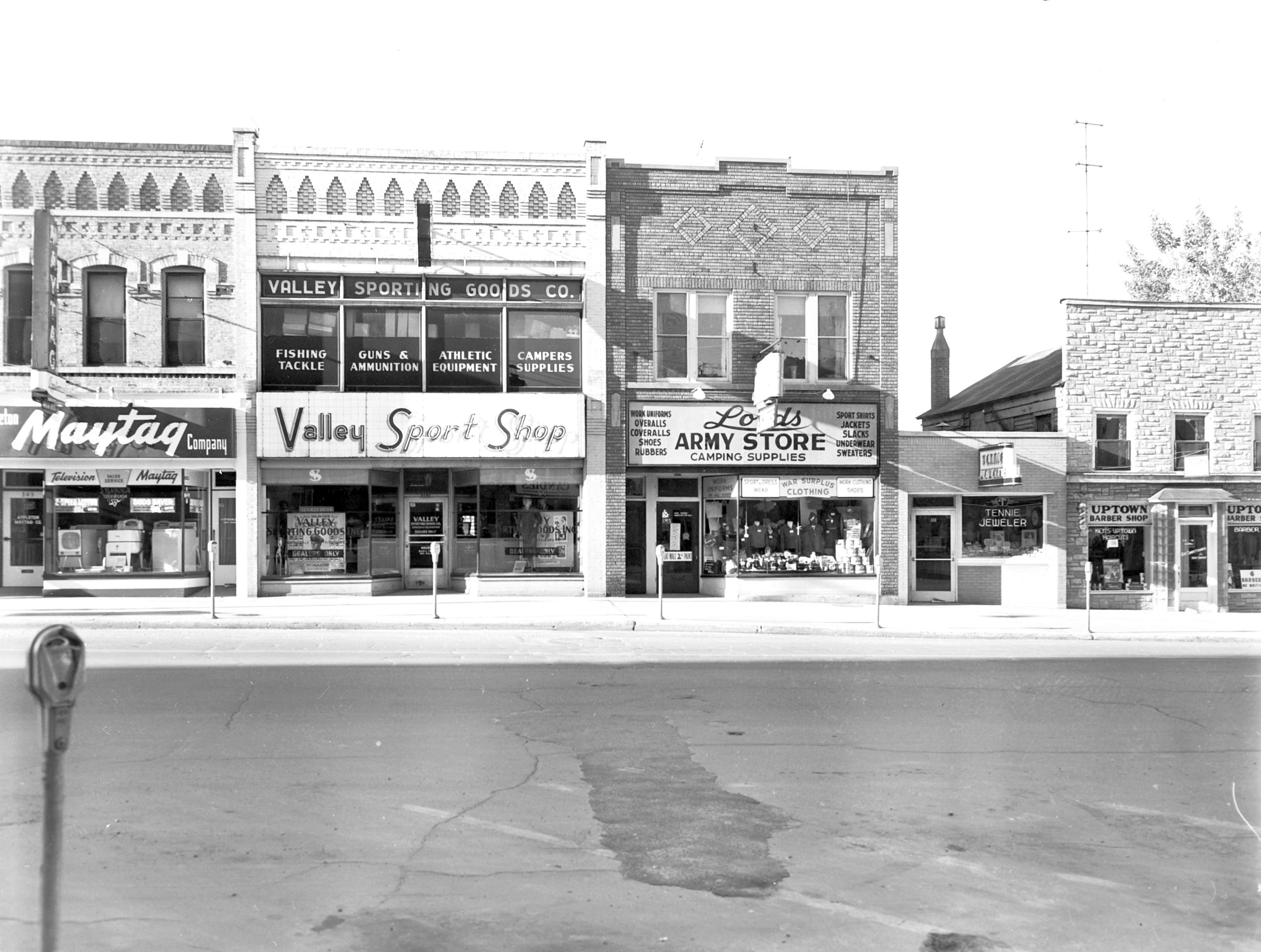 1957 Downtown Appleton. 300 West block on the south side of College Avenue: Appleton Maytag. Valley Sport Shop. Lords Army Store. Tennie Jeweler. Uptown Barber Shop.  Post-Crescent photo by staff.