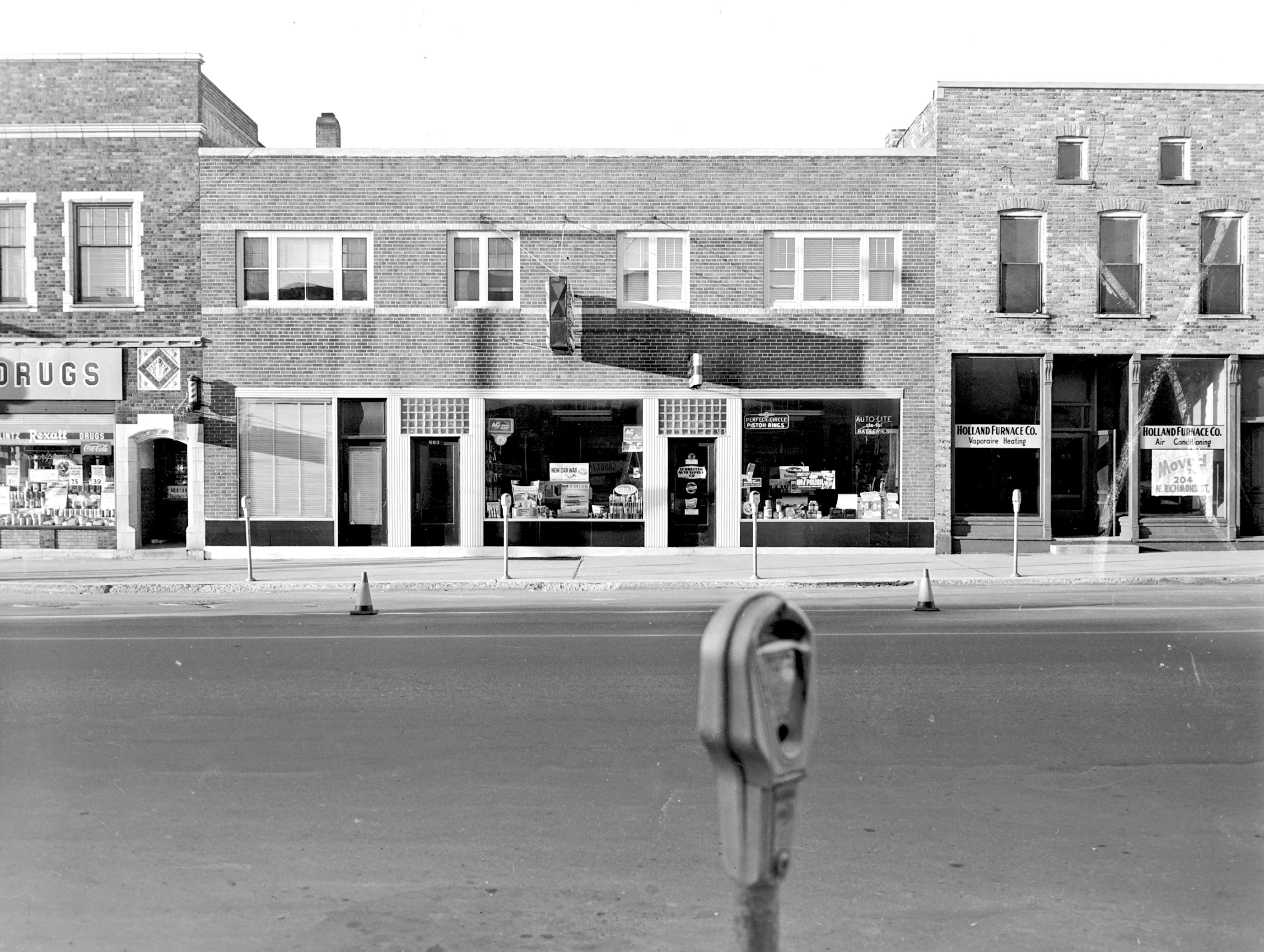 1957 Downtown Appleton. 600 West block on the south side of College Avenue: Schlintz Rexall Drugs. Schreiter Auto Supply Co. Holland Furnace Co. Post-Crescent photo by staff.