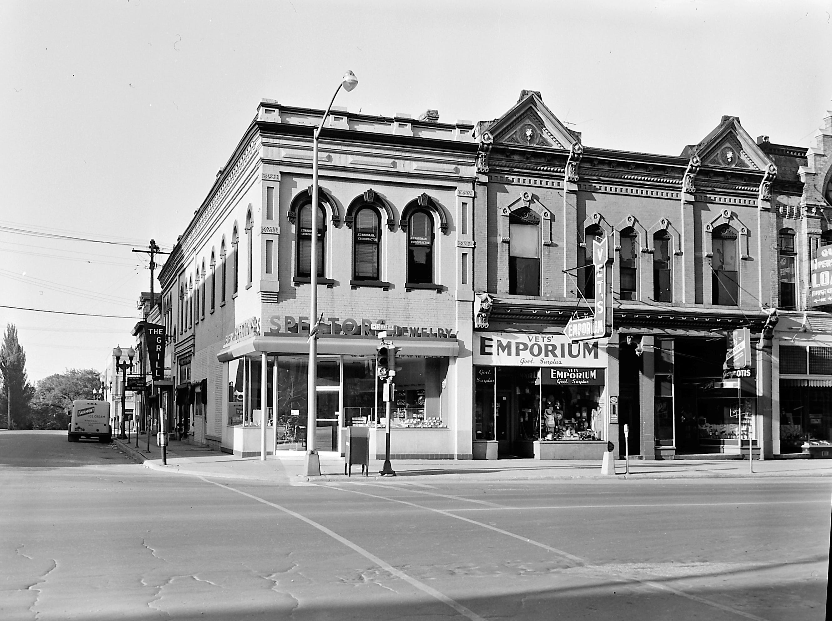1957 Downtown Appleton. 200 West block on the south side of College Avenue: Spector's Jewelry. Vet's Emporium. George Otis tavern, SHOP.   Post-Crescent photo by staff.