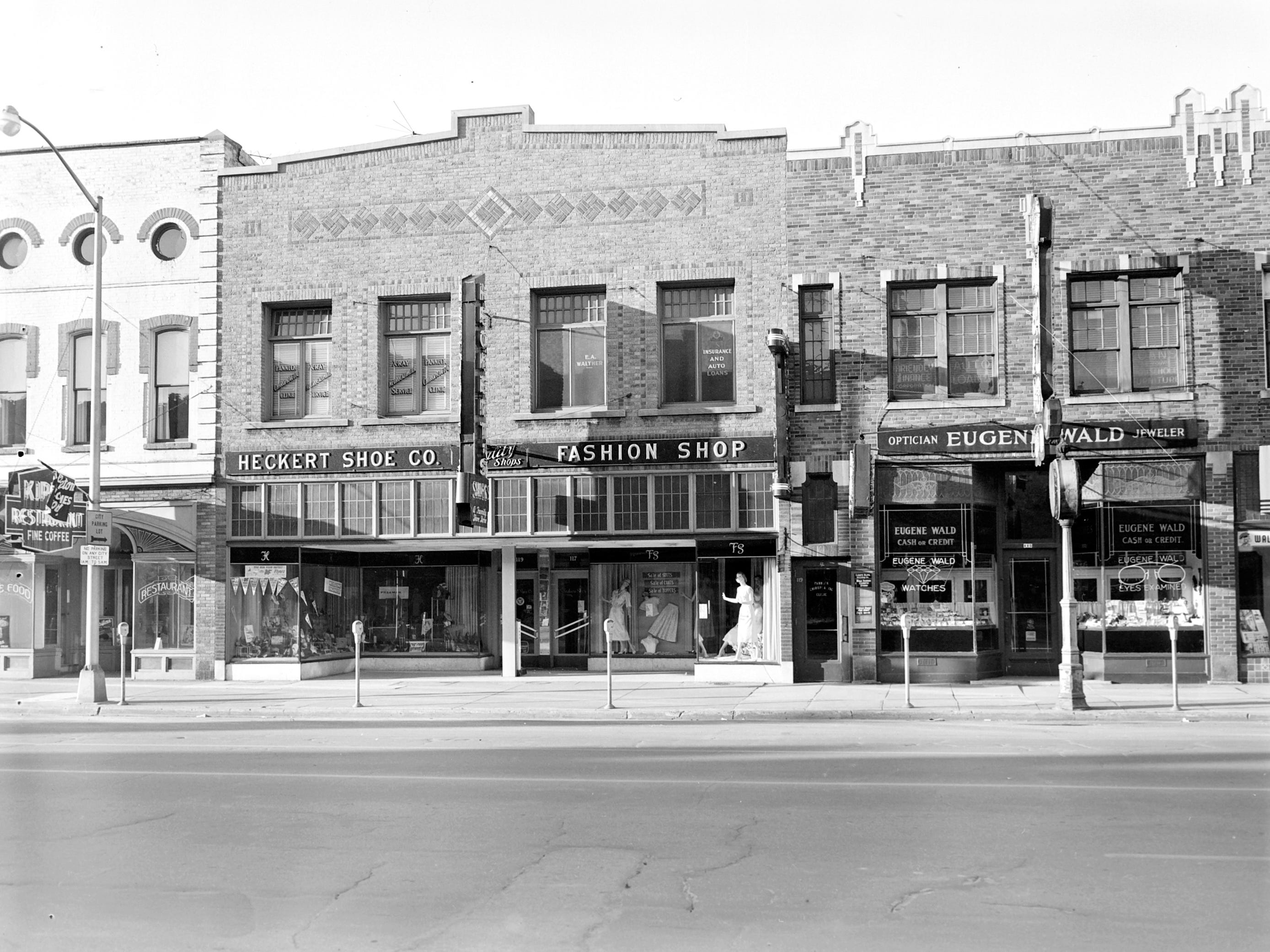 1957 Downtown Appleton. 100 East block on the south side of College Avenue: Kipps Restaurant. Heckert Shoe Co. Fashion Shop. Loans. Eugene Wald. Post-Crescent photo by staff.