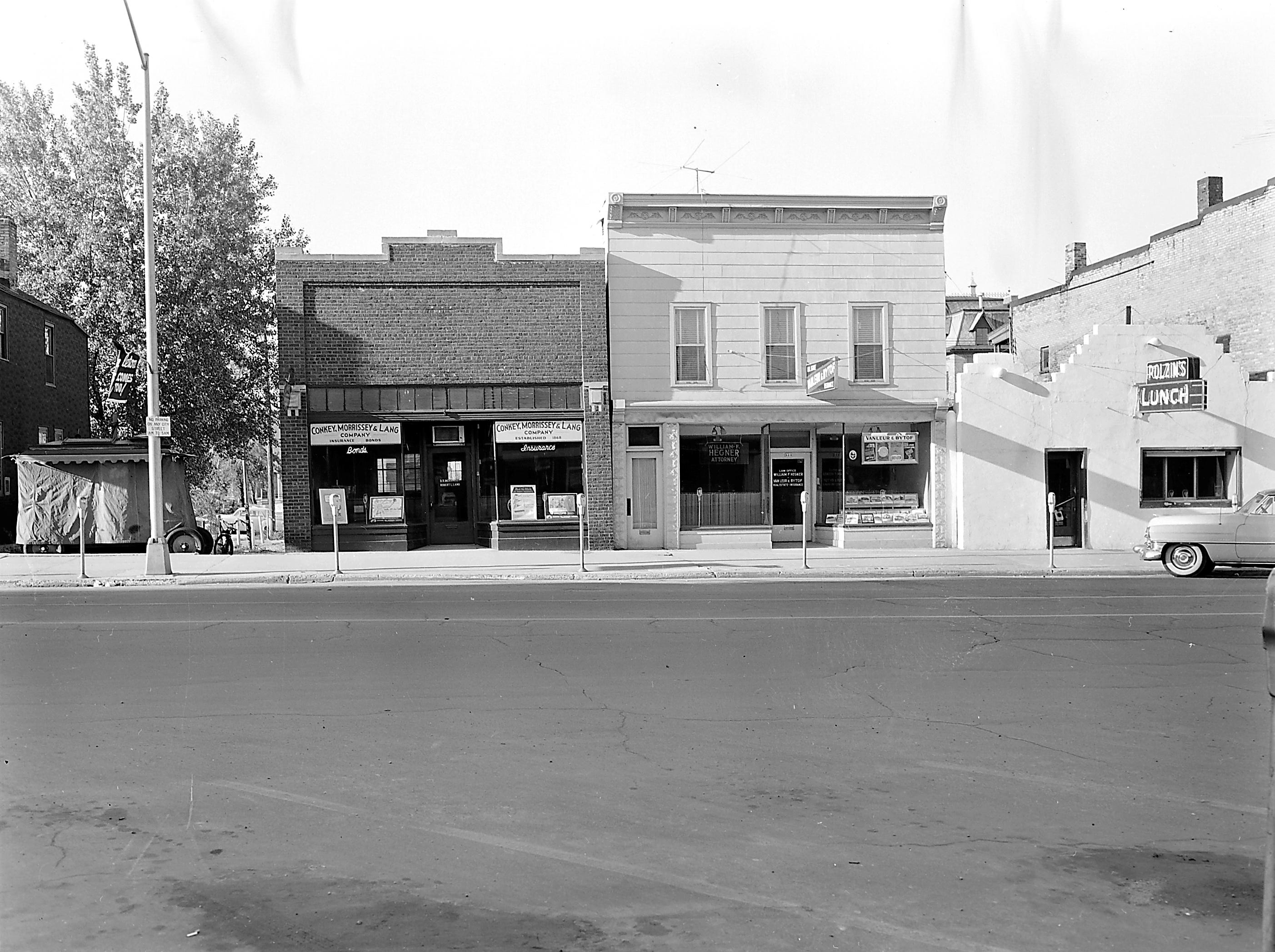 1957 Downtown Appleton. 300 West block on the south side of College Avenue: Conkey, Morrissey & Lang Company. William Hegner Attorney. Vanleur & Bytof. Polzin's Lunch. Post-Crescent photo by staff. 4x5 negative_folder C56 A