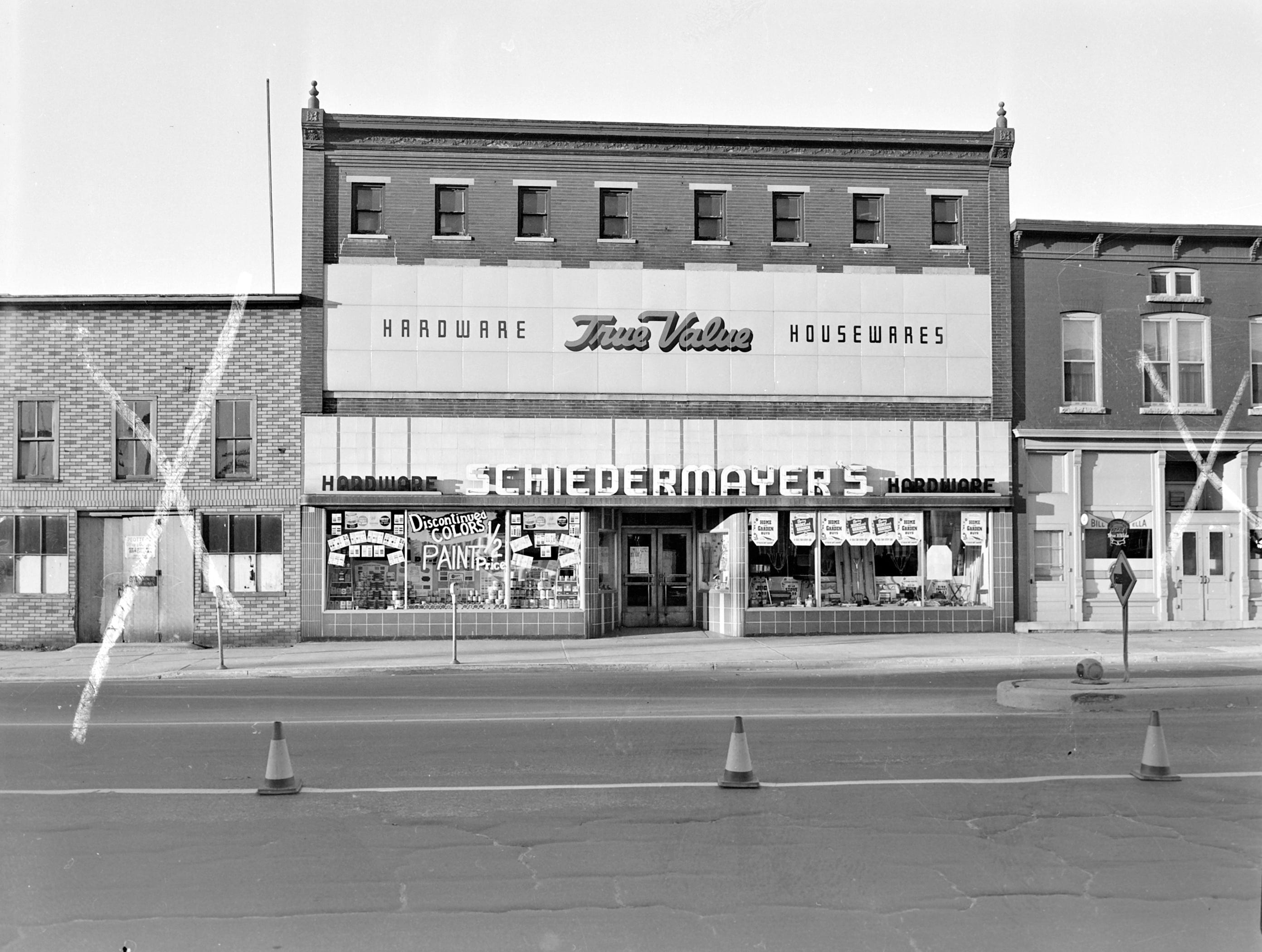 1957 Downtown Appleton. 600 West block on the south side of College Avenue: Schiedmeyer's Hardware. Bill and Ella Knorr's Bar.  Post-Crescent photo by staff.