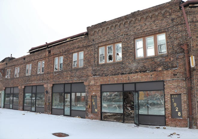 The Menasha Historical Society will receive 100 decorative bricks salvaged from the facade of the Brin Building.
