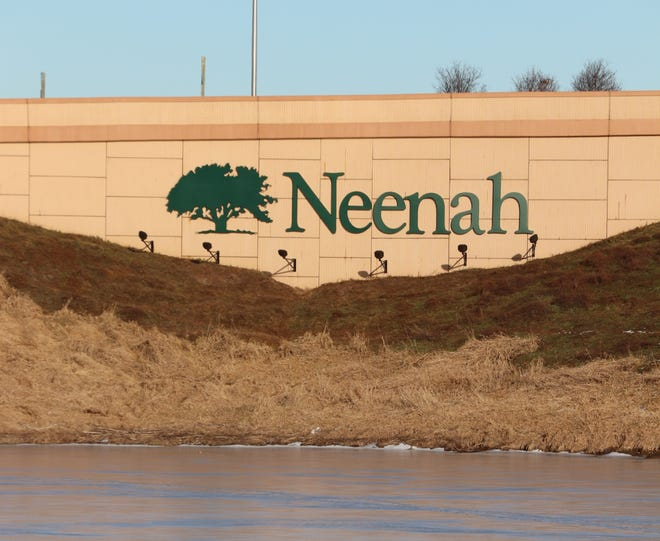 A new sign mounted on a Bell Street retaining wall promotes the city of Neenah. It is visible to motorists on northbound Interstate 41.