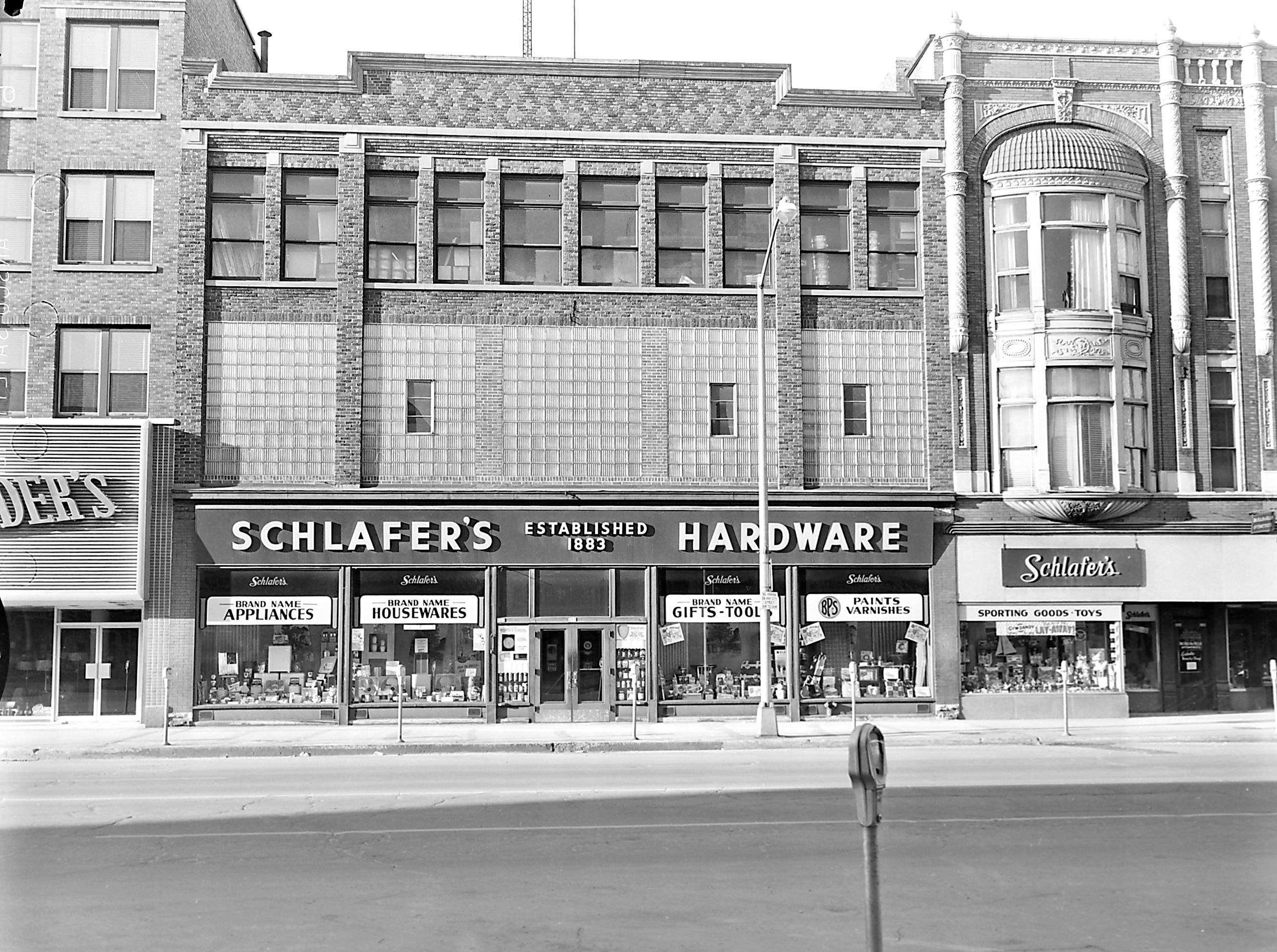 1957 Downtown Appleton. 100 West block on the south side of College Avenue: Brettschneider Furniture. Schlafer Hardware. Estelle Beauty Shop. Post-Crescent photo by staff.