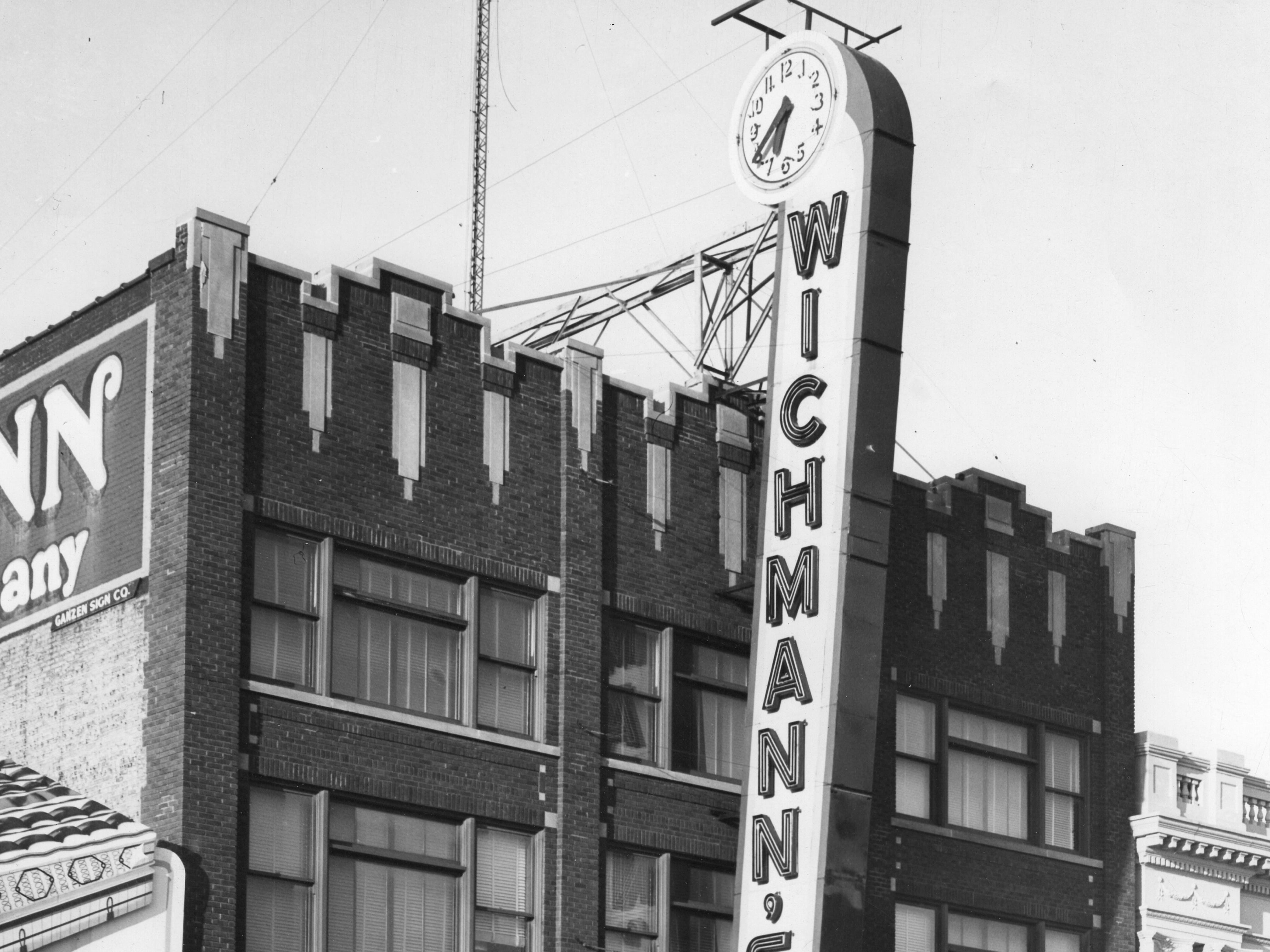 1957 Downtown Appleton. 500 West block on the south side of College Avenue: H. E. Jenkins. Wichmann's. Post-Crescent photo by staff.