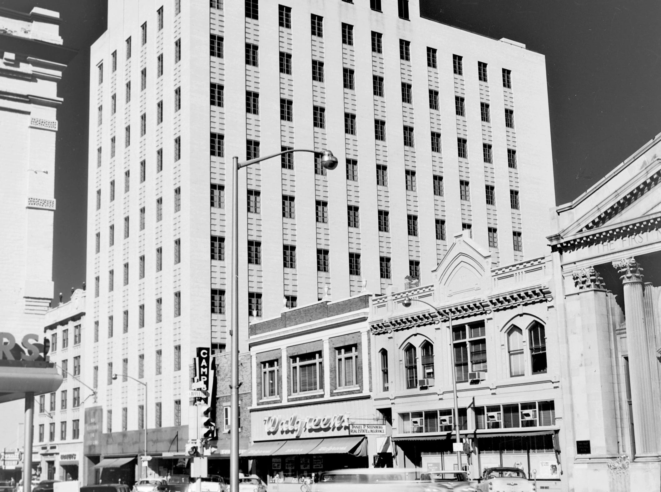 1957 Downtown Appleton. 200 West block on the north side of College Avenue: Aid Association for Lutherans. Campbell Store. Walgreens. Rueckl Studio. Daniel P. Steinberg Real Estate. STORE. First National Bank. Post-Crescent photo by staff.