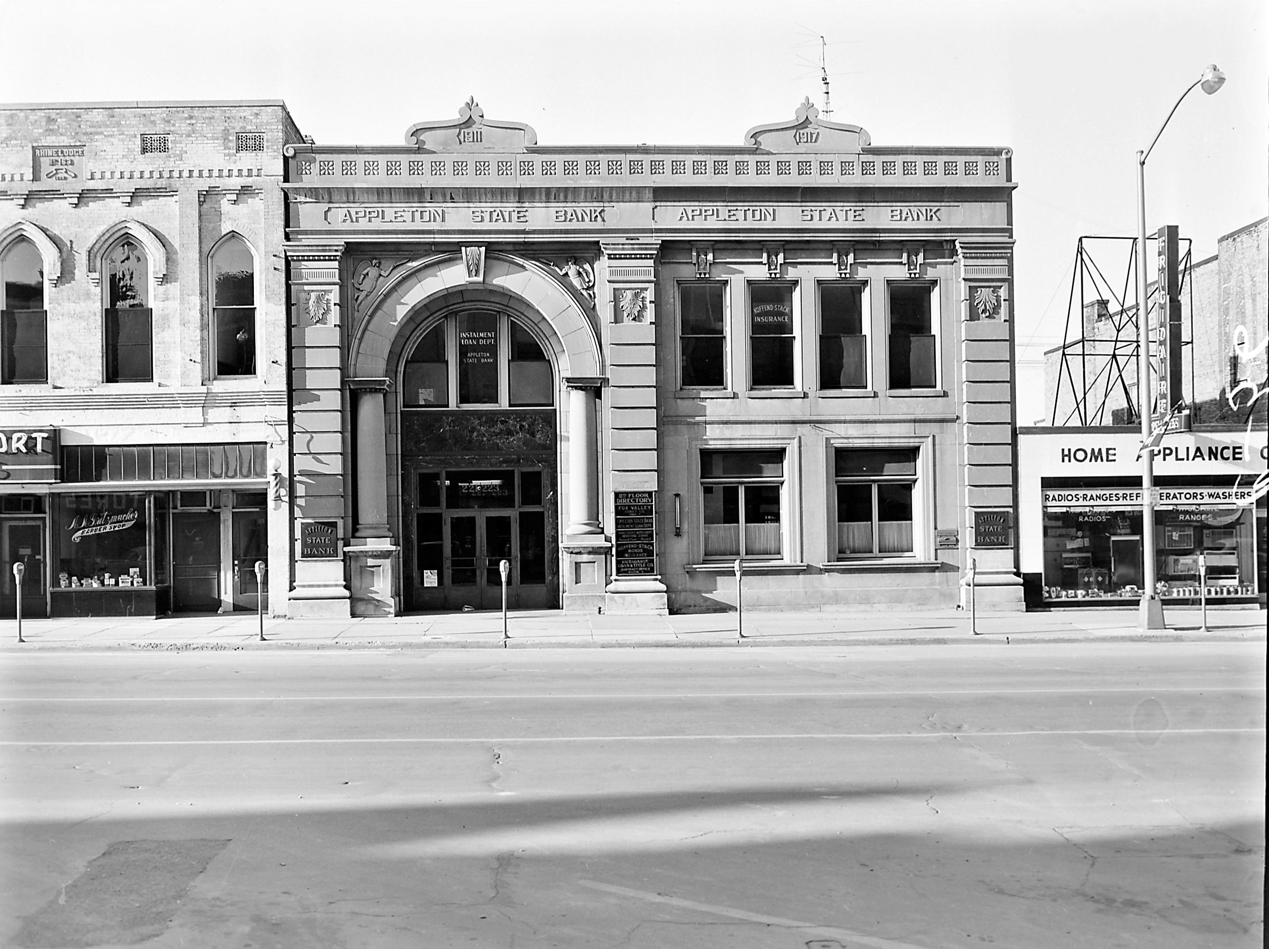 1957 Downtown Appleton. 200 West block on the south side of College Avenue: Foot-so-Port. Barber Shop. Appleton State Bank. Home Appliance. Post-Crescent photo by staff.