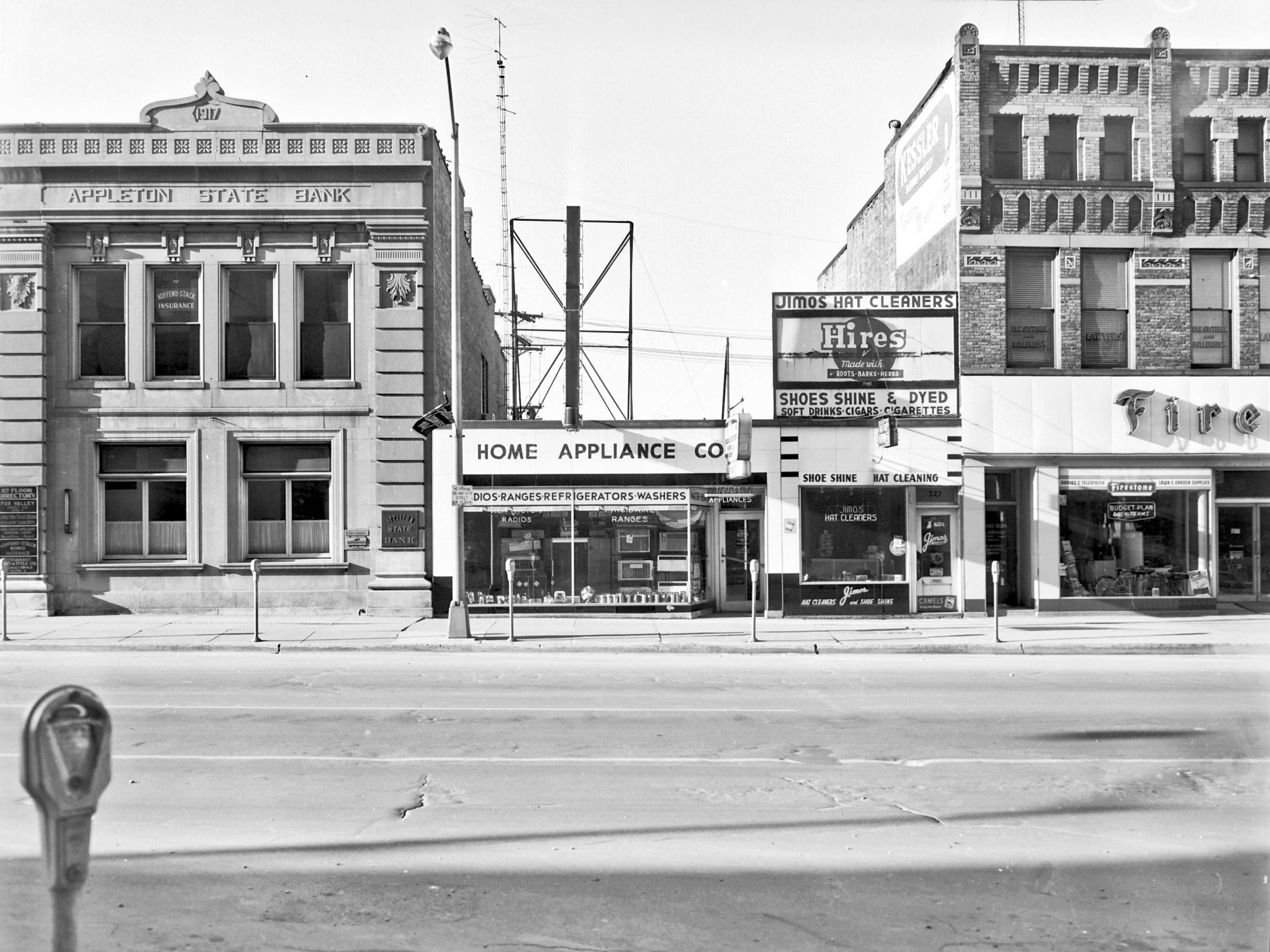 1957 Downtown Appleton. 200 West block on the south side of College Avenue: Appleton State Bank. Home Appliance Co. Jimos Hat Cleaners. Firestone. Post-Crescent photo by staff.