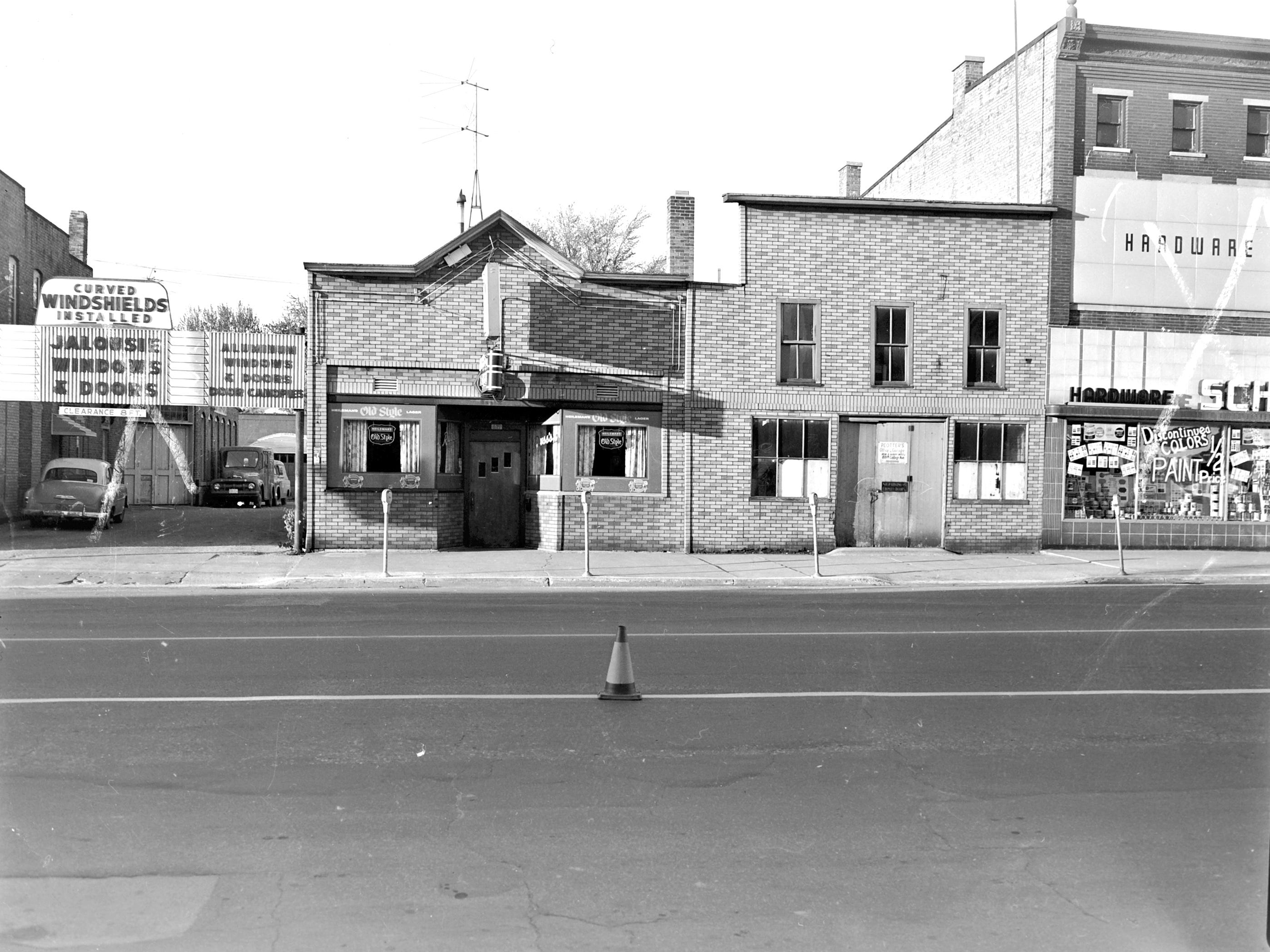 1957 Downtown Appleton. 600 West block on the south side of College Avenue: Geo J. Hoffer Glass Co. Russ's Bar. Peotter's Warehouse. Schiedermeyer's Hardware. Post-Crescent photo by staff.