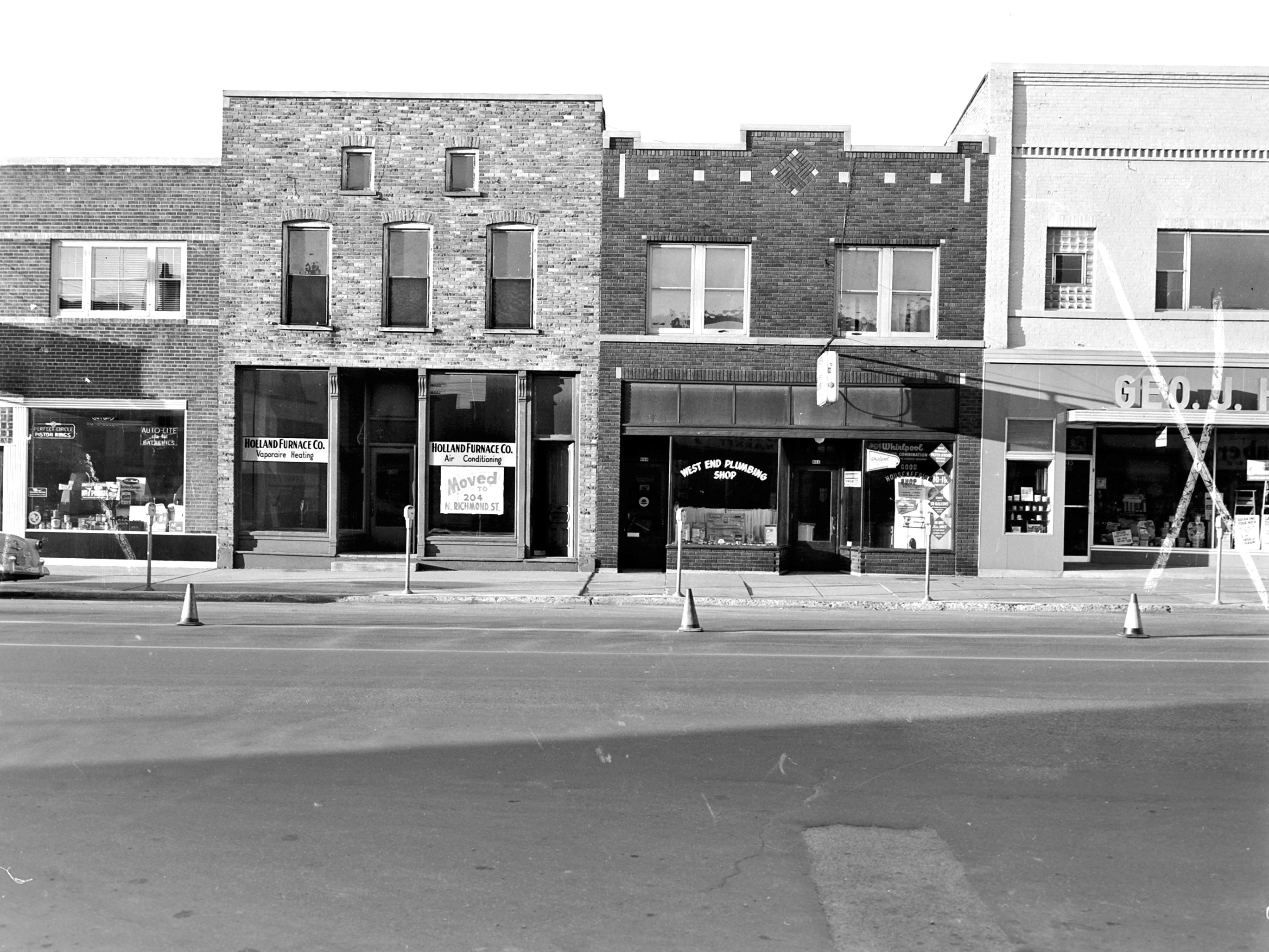 1957 Downtown Appleton. 600 West block on the south side of College Avenue: Schreiter Auto Supply Co. Holland Furnace Co. West End Plumbing. Good Housekeeping Shop. Geo J.Hoffer Glass. Post-Crescent photo by staff.