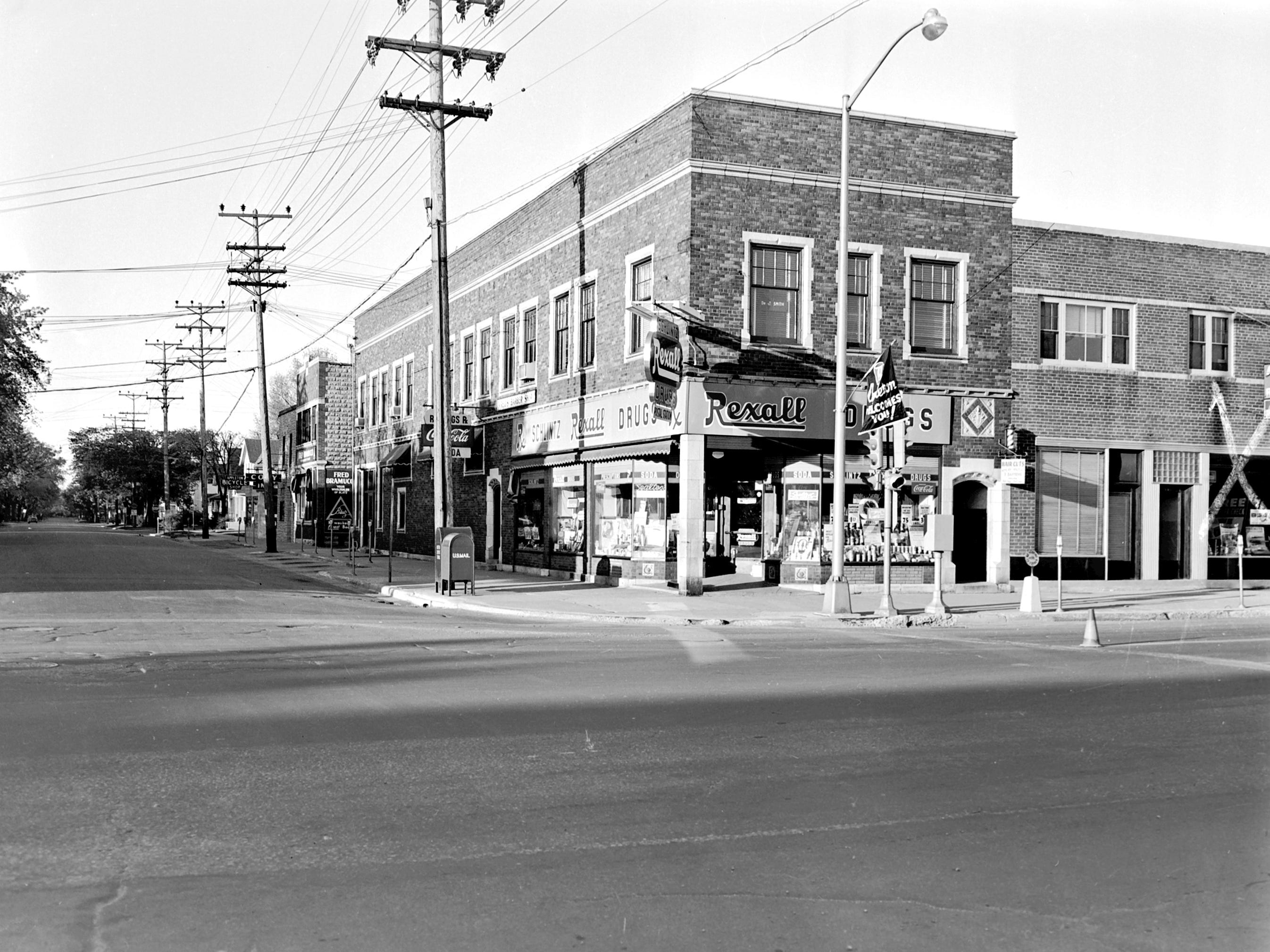 1957 Downtown Appleton. 600 West block on the south side of College Avenue: Schlintz Rexall Drugs. Schreiter Auto Supply Co. Post-Crescent photo by staff.