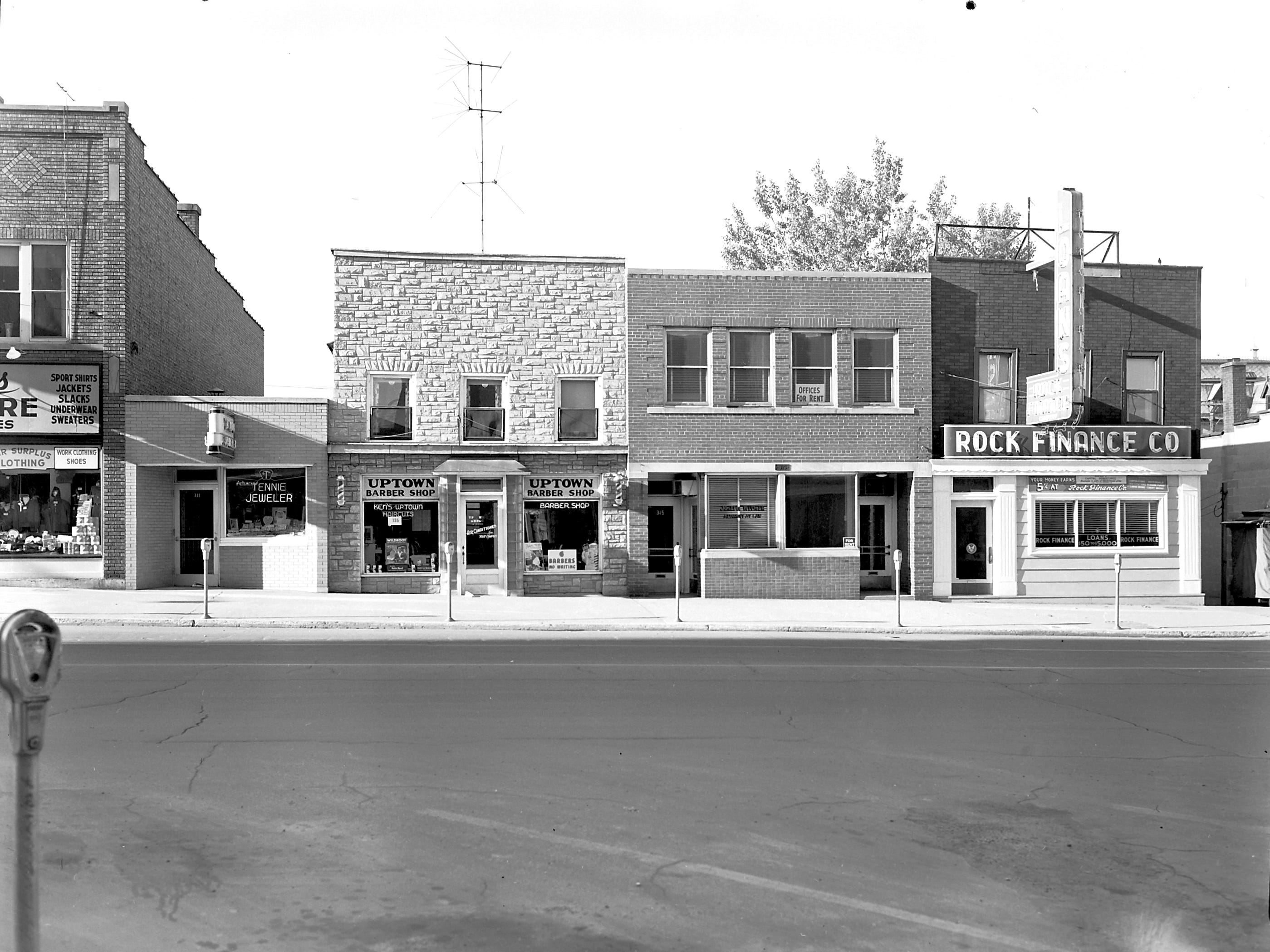 1957 Downtown Appleton. 300 West block on the south side of College Avenue: Lord's Army Store. Tennie Jeweler. Uptown Barber Shop. Jos Witmar Attorney. Rock Finance Co. Post-Crescent photo by staff.