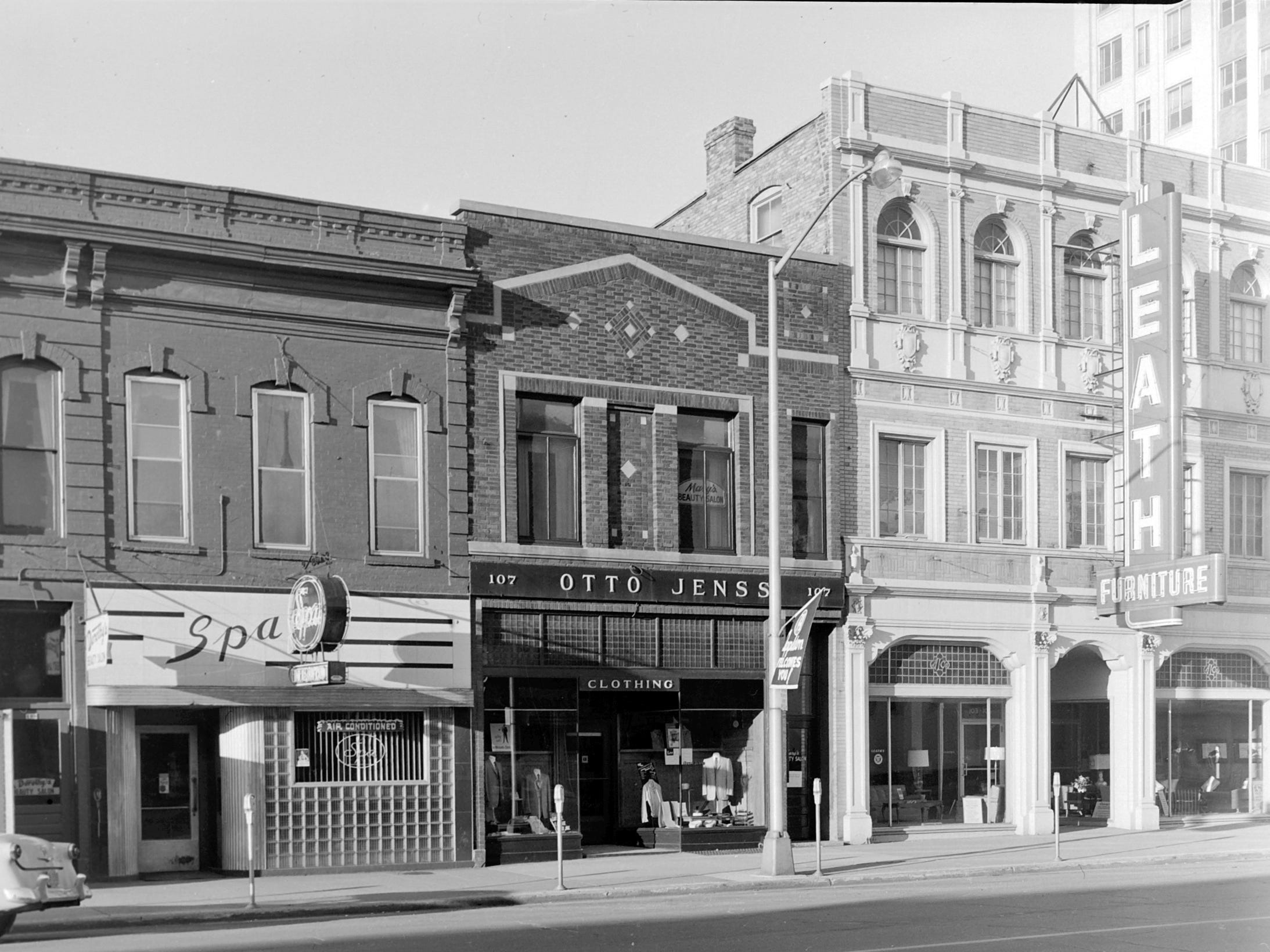 1957 Downtown Appleton. 100 East block on the south side of College Avenue: Spa Lounge.  Otto Jenss Mens Shop. Leath Furniture. Post-Crescent photo by staff.