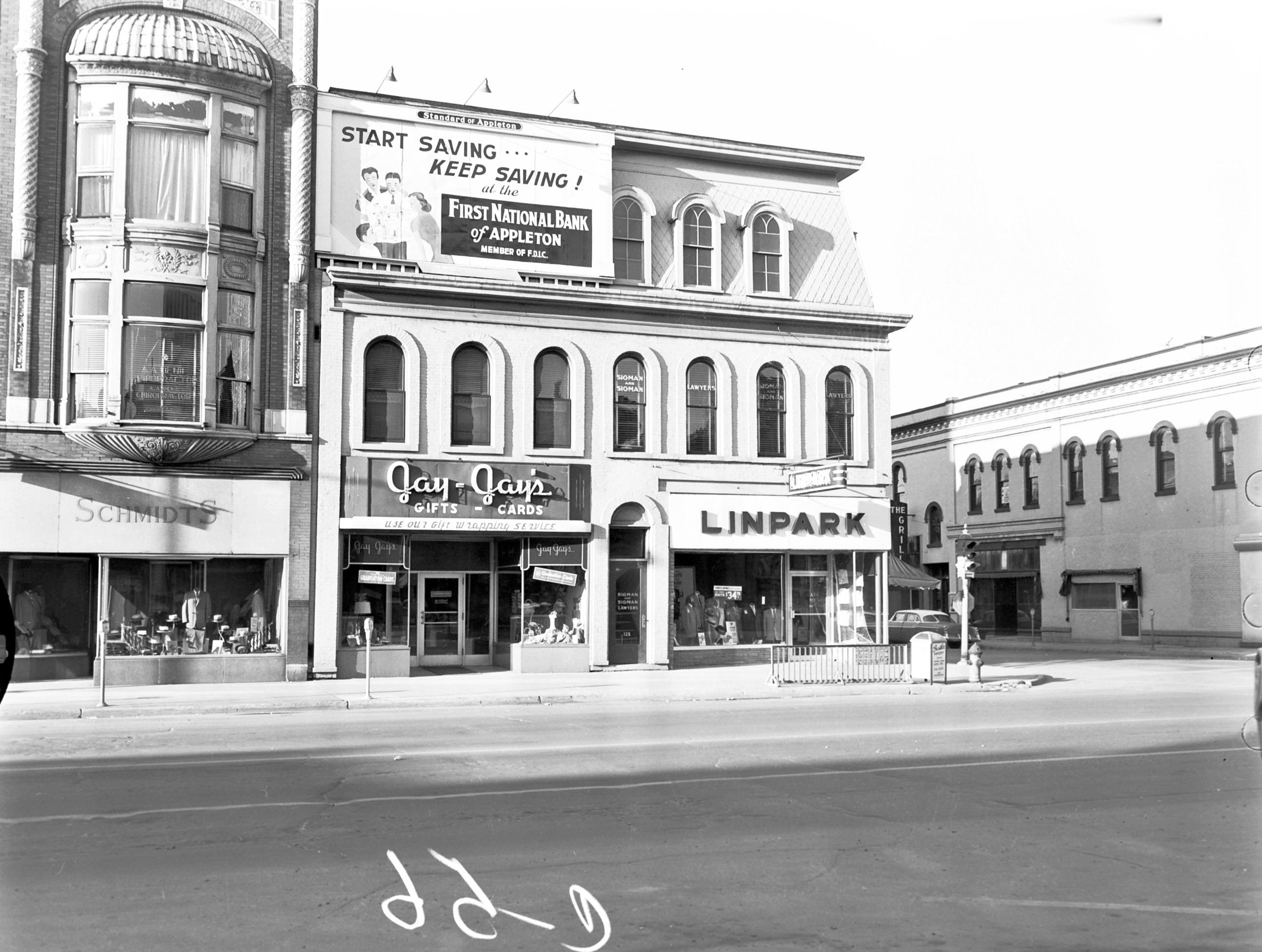 1957 Downtown Appleton. 100 West block on the south side of College Avenue: Matt Schmitt Men's. Jay-Jays. LinPark Clothing. Post-Crescent photo by staff.