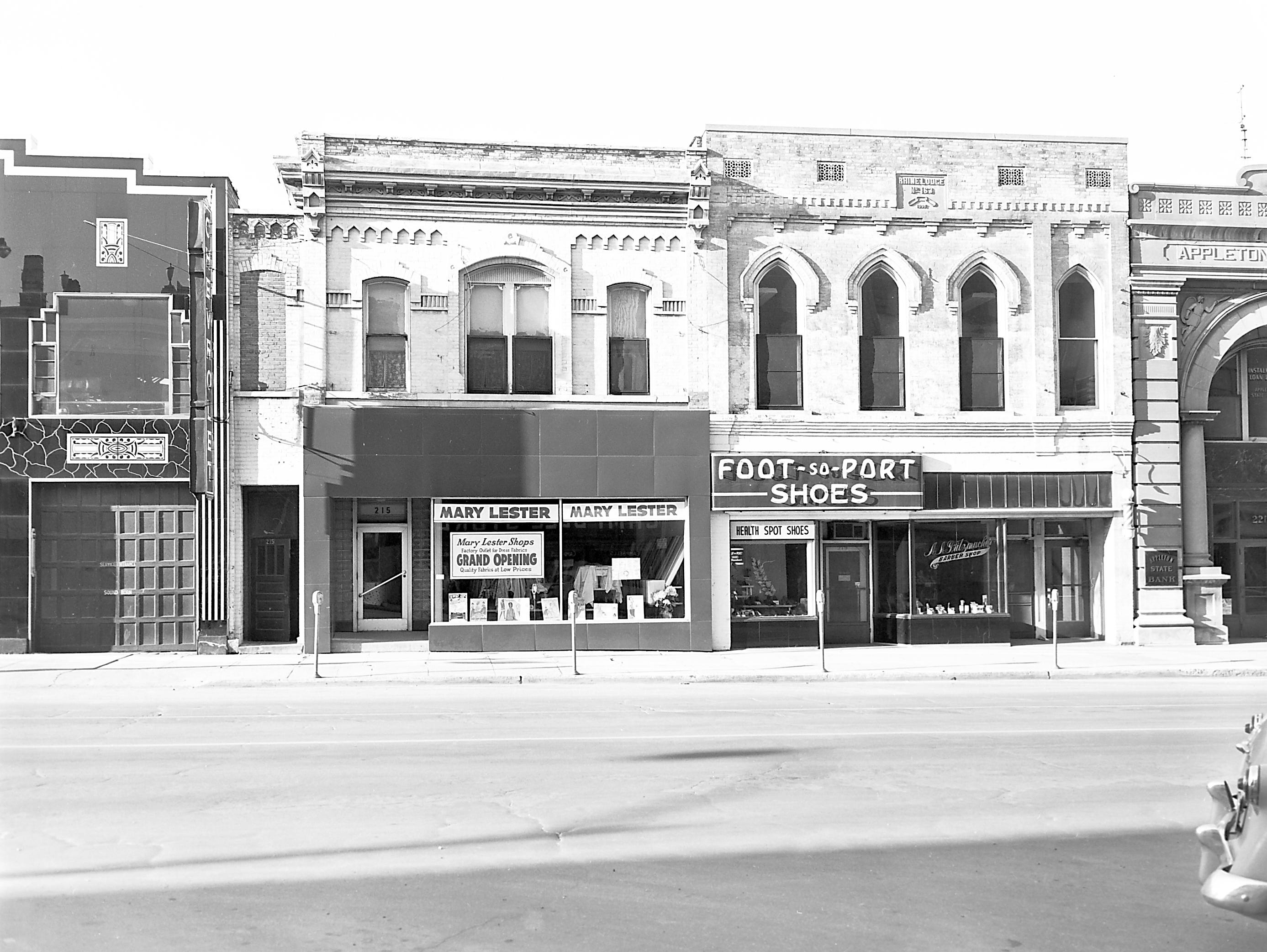 1957 Downtown Appleton. 200 West block on the south side of College Avenue: Gibson Motor's. Mary Lester Shop. Foot-so-Port Shoes. Barber shop. Appleton State Bank. Post-Crescent photo by staff
