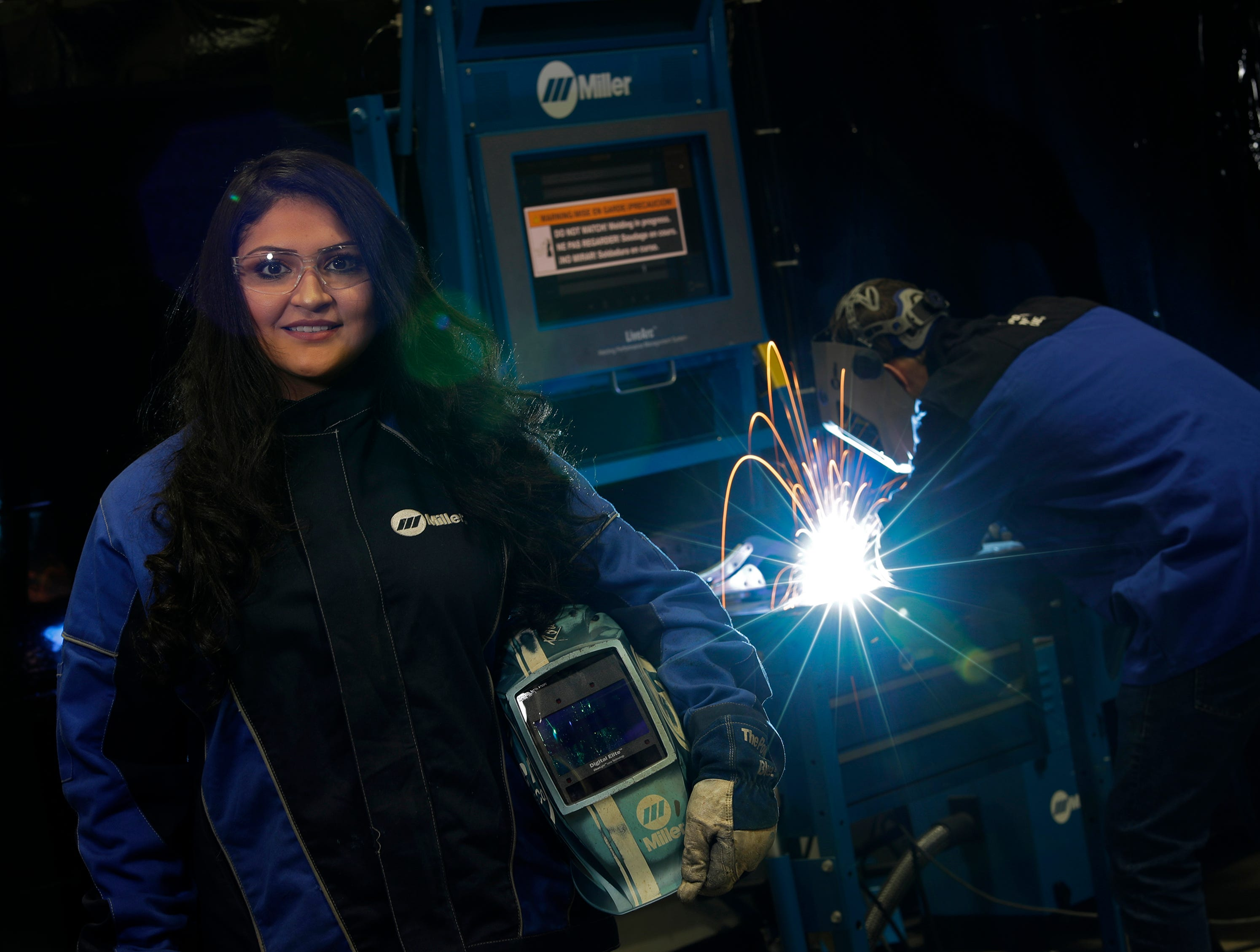 Fox Valley Technical College student Olivia Arreola is the first person to graduate after benefitting from the school's Promise program. She is currently interning at Miller Electric and is pictured here Wednesday, December 12, 2018, in Appleton, Wis. 